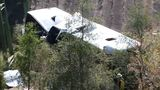 1 killed after charter bus carrying 46 plunges down Alabama ravine