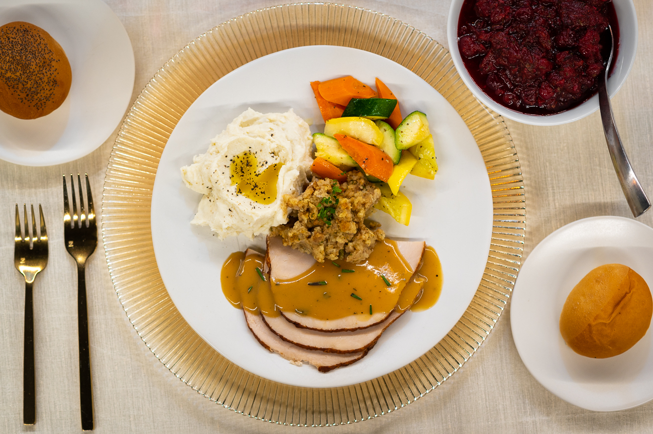 The Take and Back Holiday Dinner. Pictured: oven-roasted turkey breast with rosemary sage sauce, seasonal vegetable medley, traditional holiday stuffing, and butter-whipped mashed potatoes. / Image: Phil Armstrong, Cincinnati Refined // Published: 11.6.20