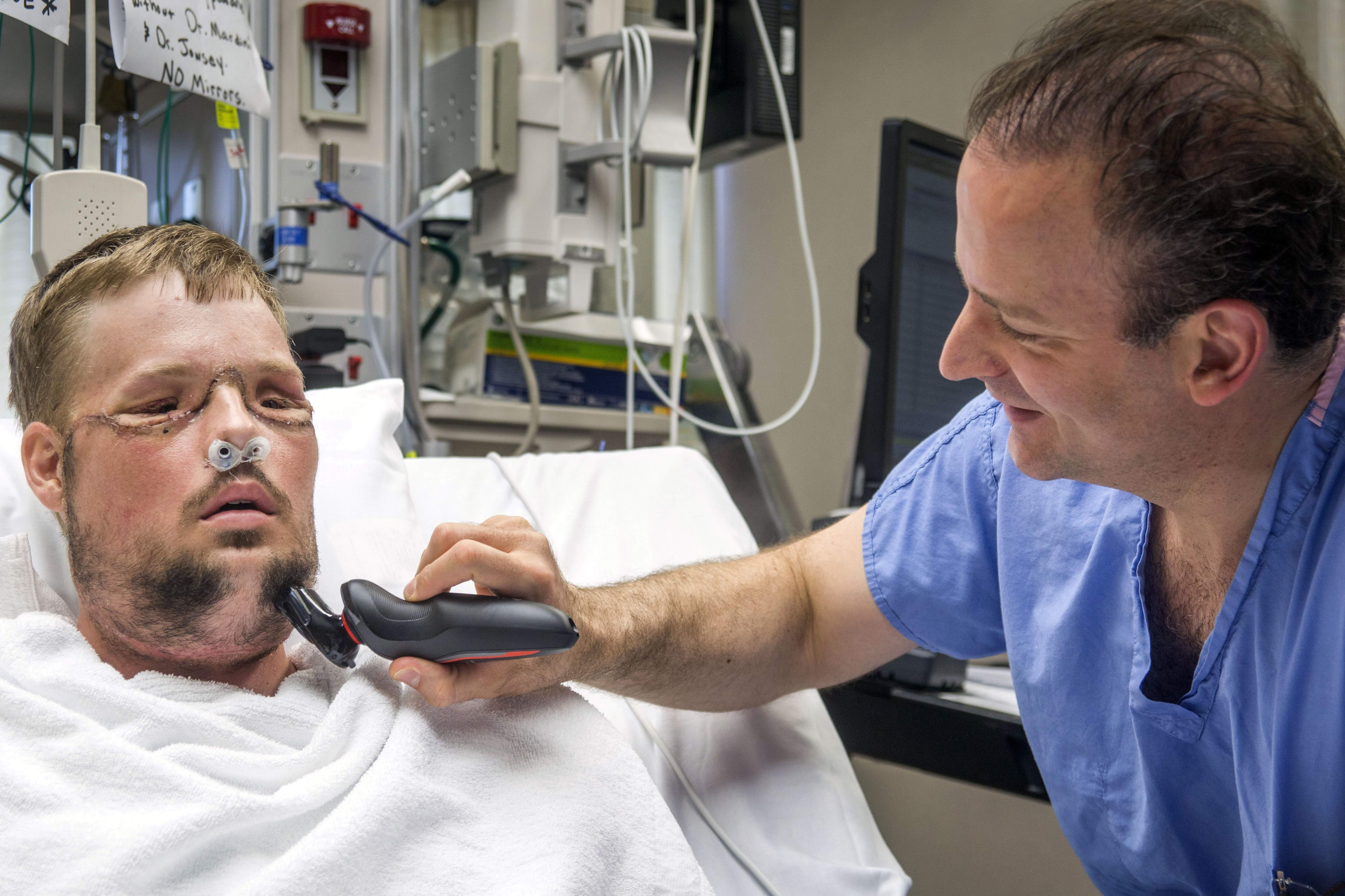 In this July 3, 2016 photo provided by the Mayo Clinic, Dr. Samir Mardini shaves the face of his patient, Andy Sandness, days after leading a team that performed the first face transplant surgery at the hospital. THE ASSOCIATED PRESS