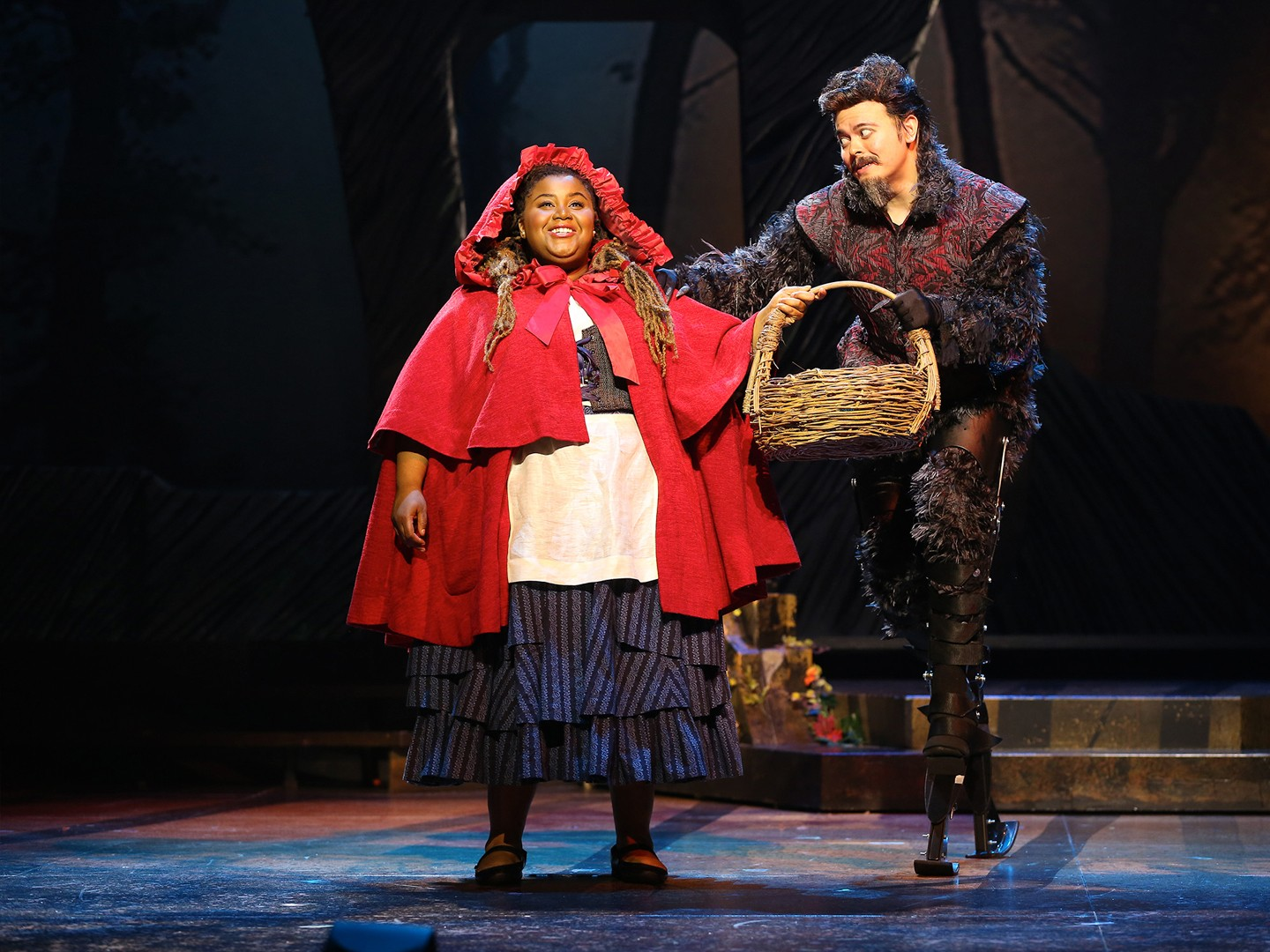 "Jade Jones as Little Red Riding Hood and Christopher Mueller as First Wolf in Ford Theatre's production of ""Into the Woods."" (Image: Carol Rosegg)<p></p><p><br></p>"