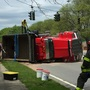 Dump truck flips in front of St. John Fisher