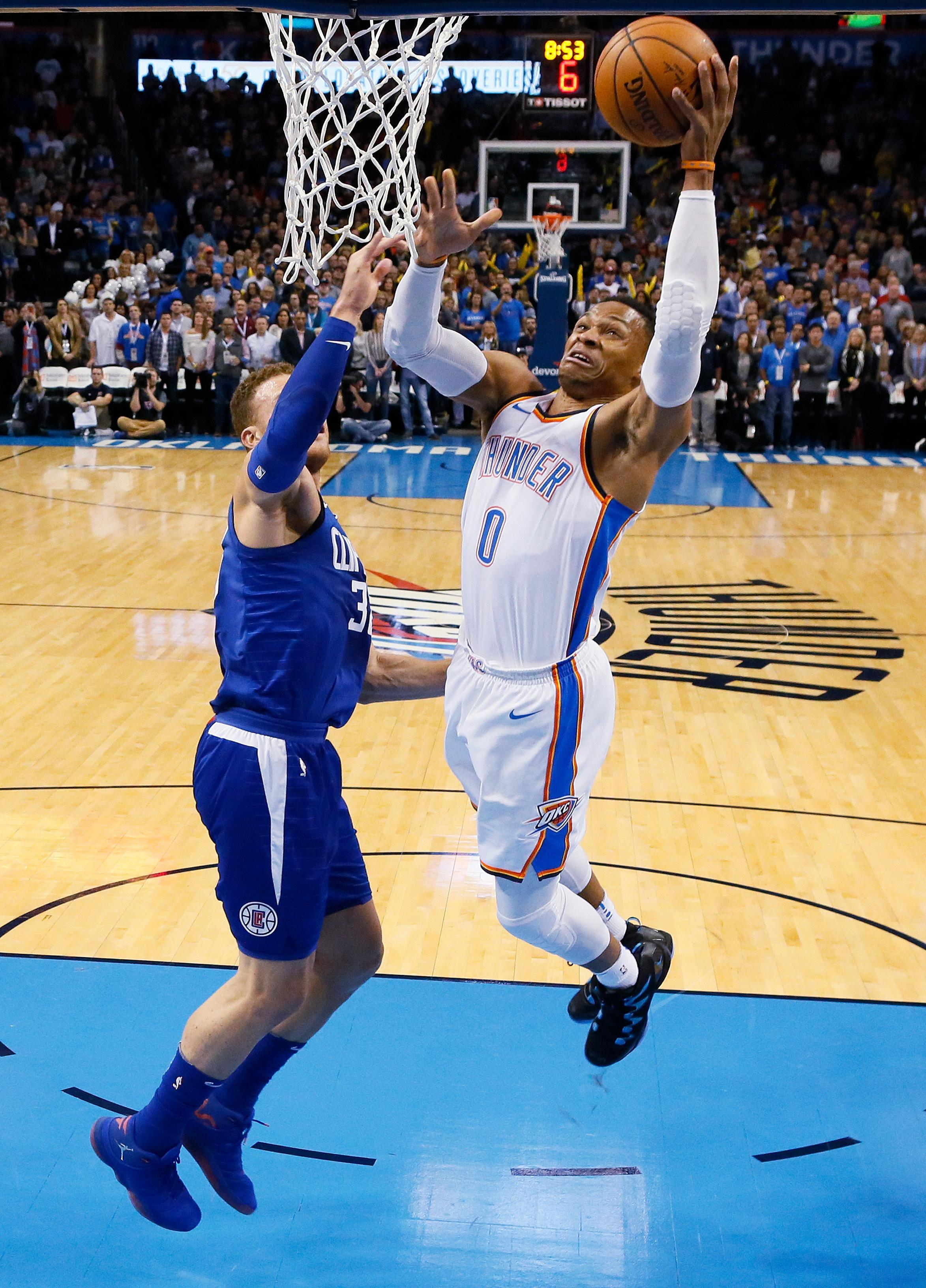 Oklahoma City Thunder guard Russell Westbrook, left, shoots in front of Los Angeles Clippers forward Blake Griffin (32) in the first quarter of an NBA basketball game in Oklahoma City, Friday, Nov. 10, 2017. (AP Photo/Sue Ogrocki)