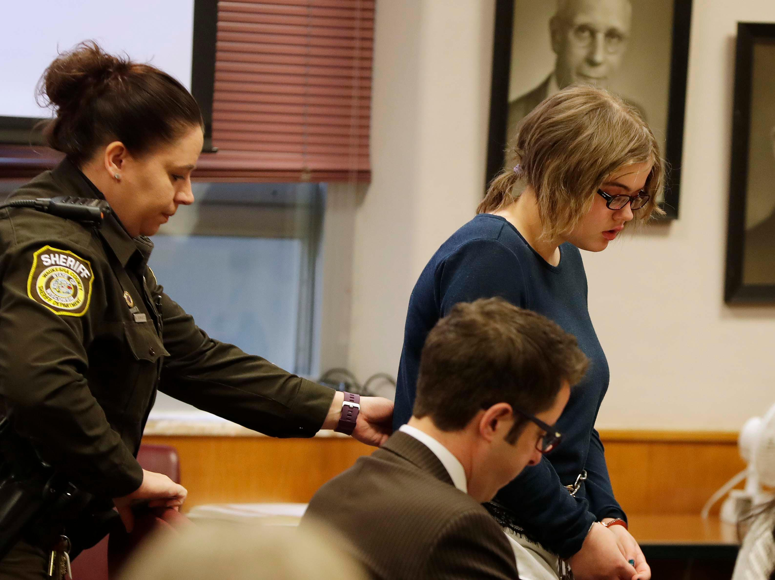 Morgan Geyser, 15,  appears for sentencing before Waukesha County Circuit Judge Michael Bohren, Thursday, Feb. 1, 2018 in Waukesha, Wis.   Geyser is one of two girls who tried to kill a classmate with a knife to appease fictional horror character Slender Man.  Prosecutors want Geyser to spend the maximum 40 years in a mental hospital for stabbing Payton Leutner in suburban Milwaukee in 2014.  (Rick Wood/Milwaukee Journal-Sentinel via AP, Pool)