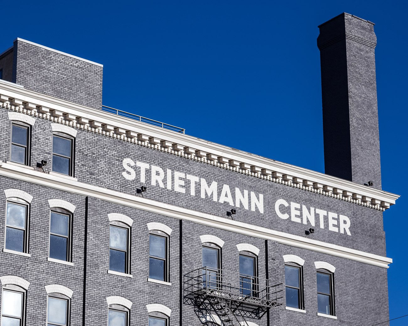 The Strietmann Center is an 88,000-square-foot office building at the corner of 12th Street and Central Parkway in Over-the-Rhine. It was originally built in 1899 for the Strietmann Biscuit Company along the Miami and Erie Canal (now Central Parkway) due to the business' booming success. Peg Wyant purchased the building in 2016 and transformed it into an office building for prospective tenants. As of publishing this, floors are still being leased. ADDRESS: 235 W. 12th Street (45202) / Image: Phil Armstrong, Cincinnati Refined // Published: 3.9.18