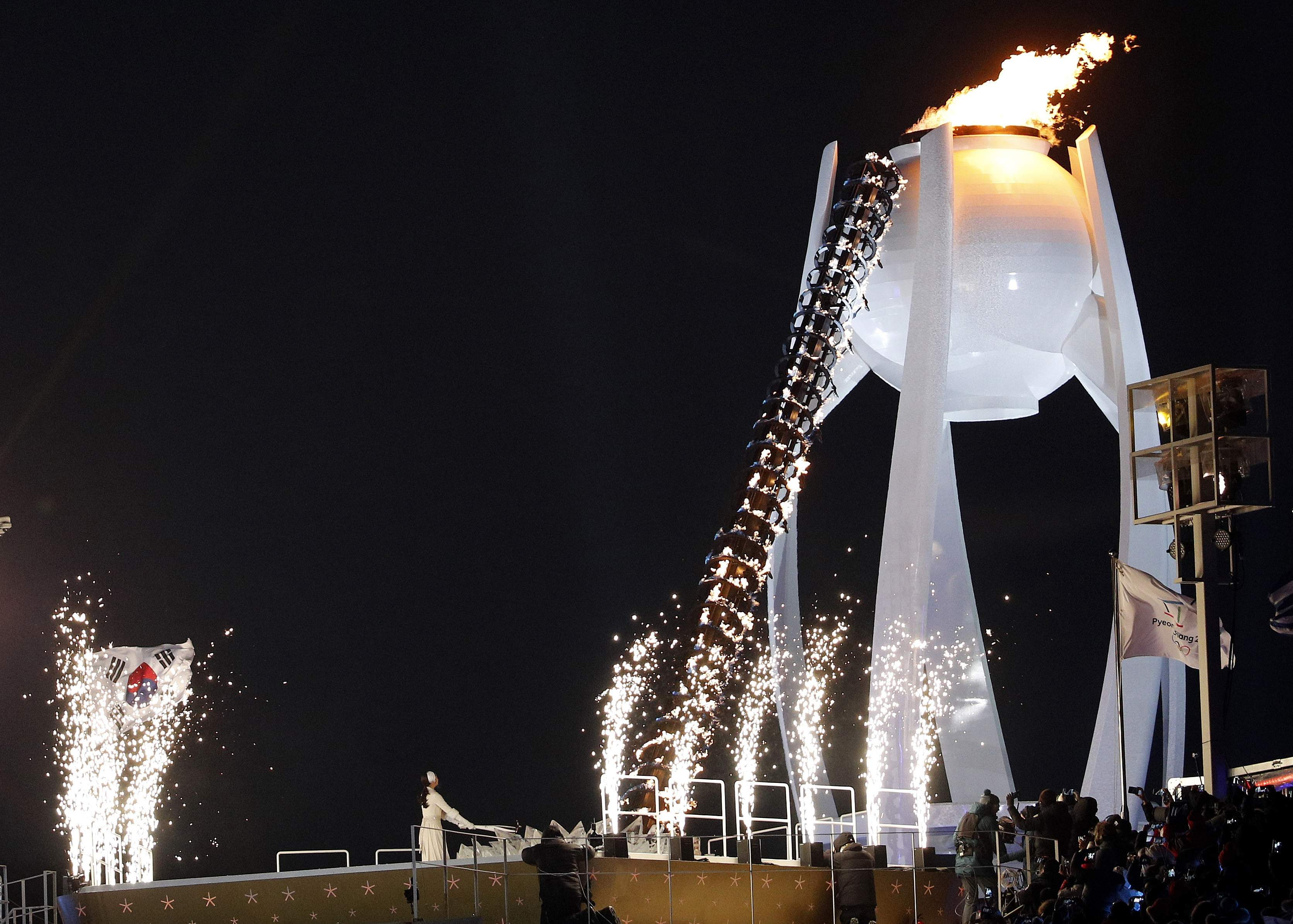 Yuna Kim lights Olympic flame during the opening ceremony of the 2018 Winter Olympics in Pyeongchang, South Korea, Friday, Feb. 9, 2018. (AP Photo/Christophe Ena)
