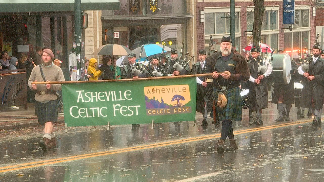 Despite the rain and the cold today, people lined the streets for Asheville's 73rd annual Holiday Parade. (Photo credit: WLOS Staff)
