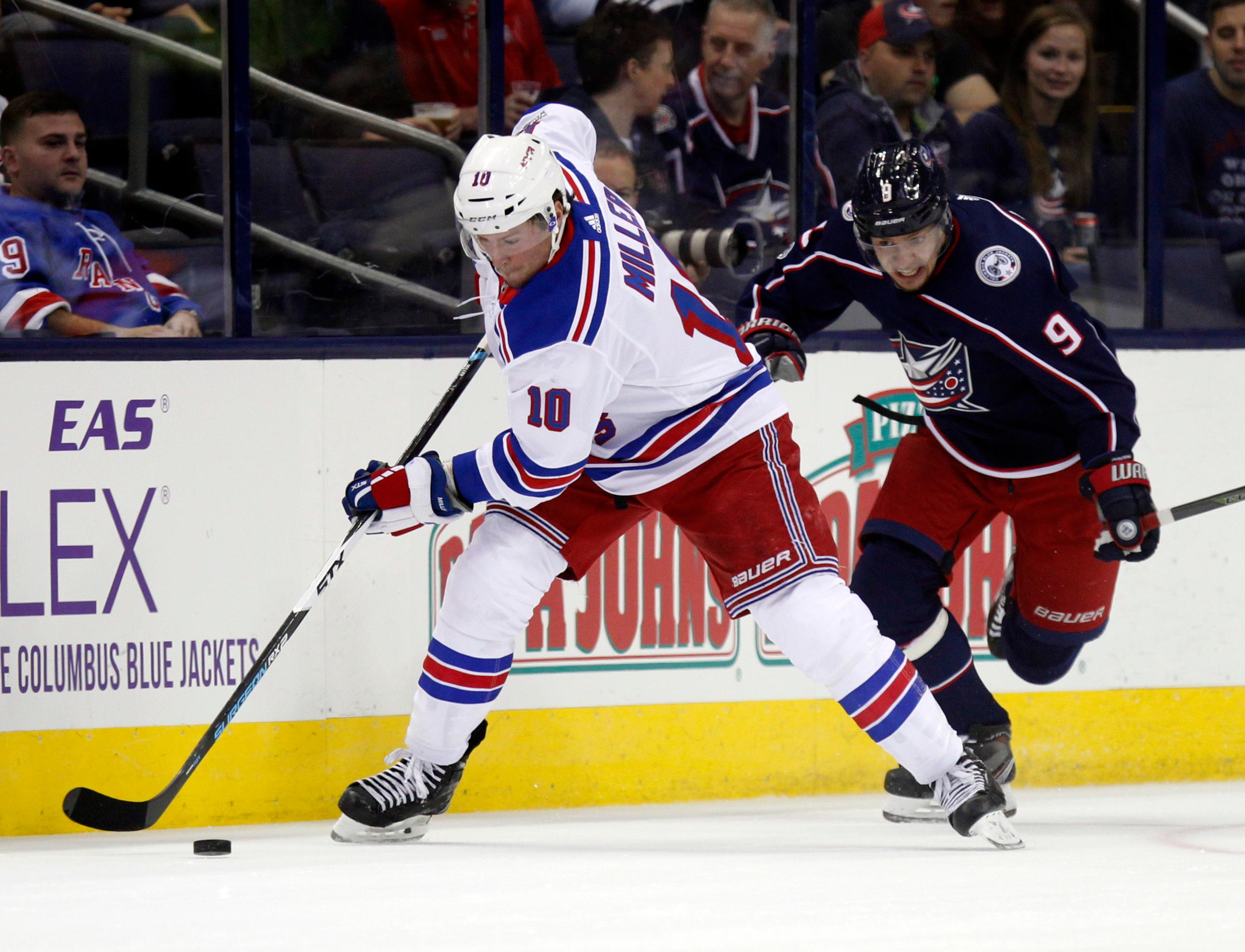 New York Rangers forward J.T. Miller, left, works for the puck against Columbus Blue Jackets forward Artemi Panarin, of Russia, during the first period of an NHL hockey game in Columbus, Ohio, Friday, Oct. 13, 2017. (AP Photo/Paul Vernon)