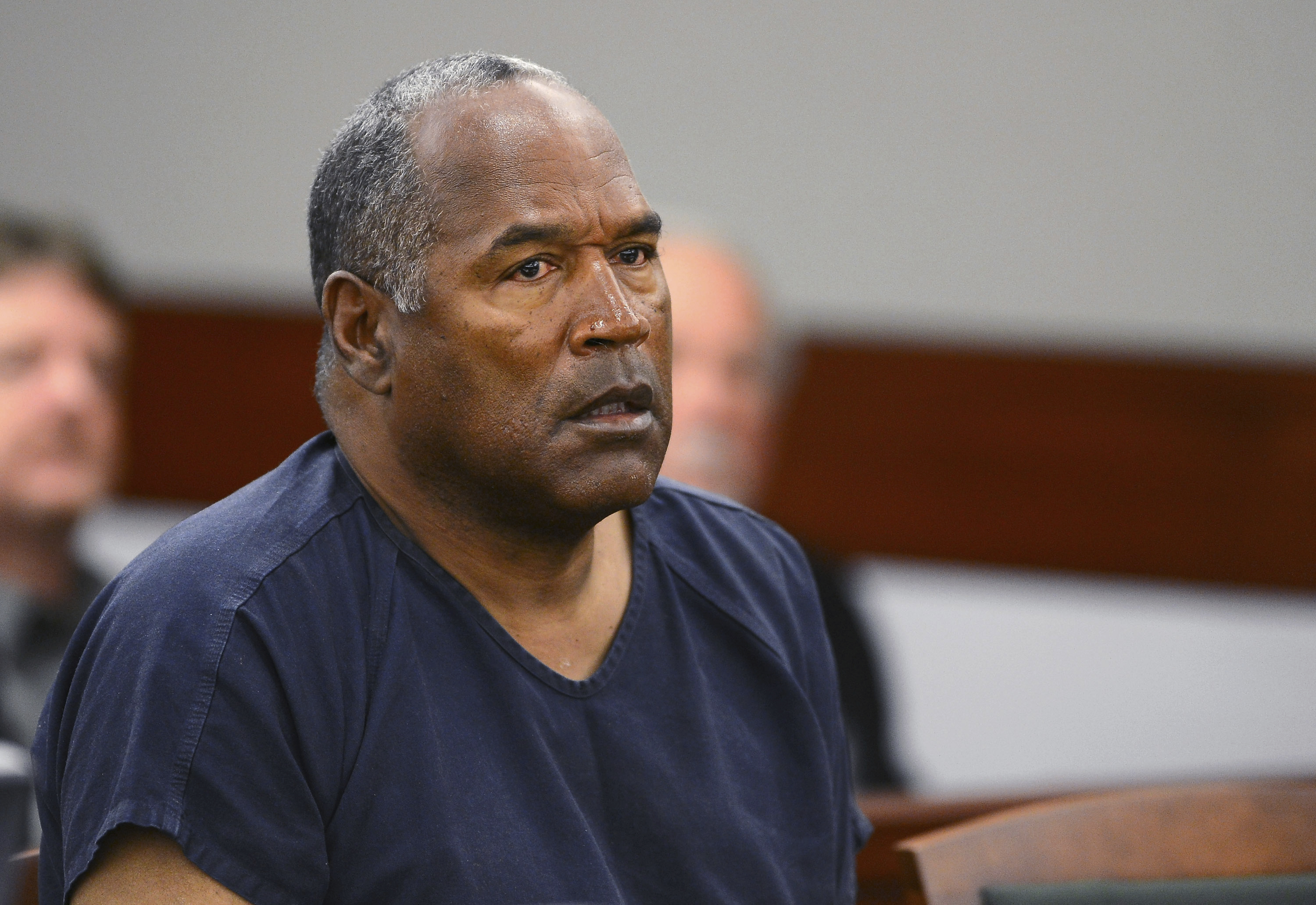 FILE - In this May 14, 2013, file photo, O.J. Simpson appears at an evidentiary hearing in Clark County District Court in Las Vegas. A Nevada prison official said early Sunday, Oct. 1, 2017, O.J. Simpson, the former football legend and Hollywood star, has been released from a Nevada prison in Lovelock after serving nine years for armed robbery. (Ethan Miller via AP, Pool, File)