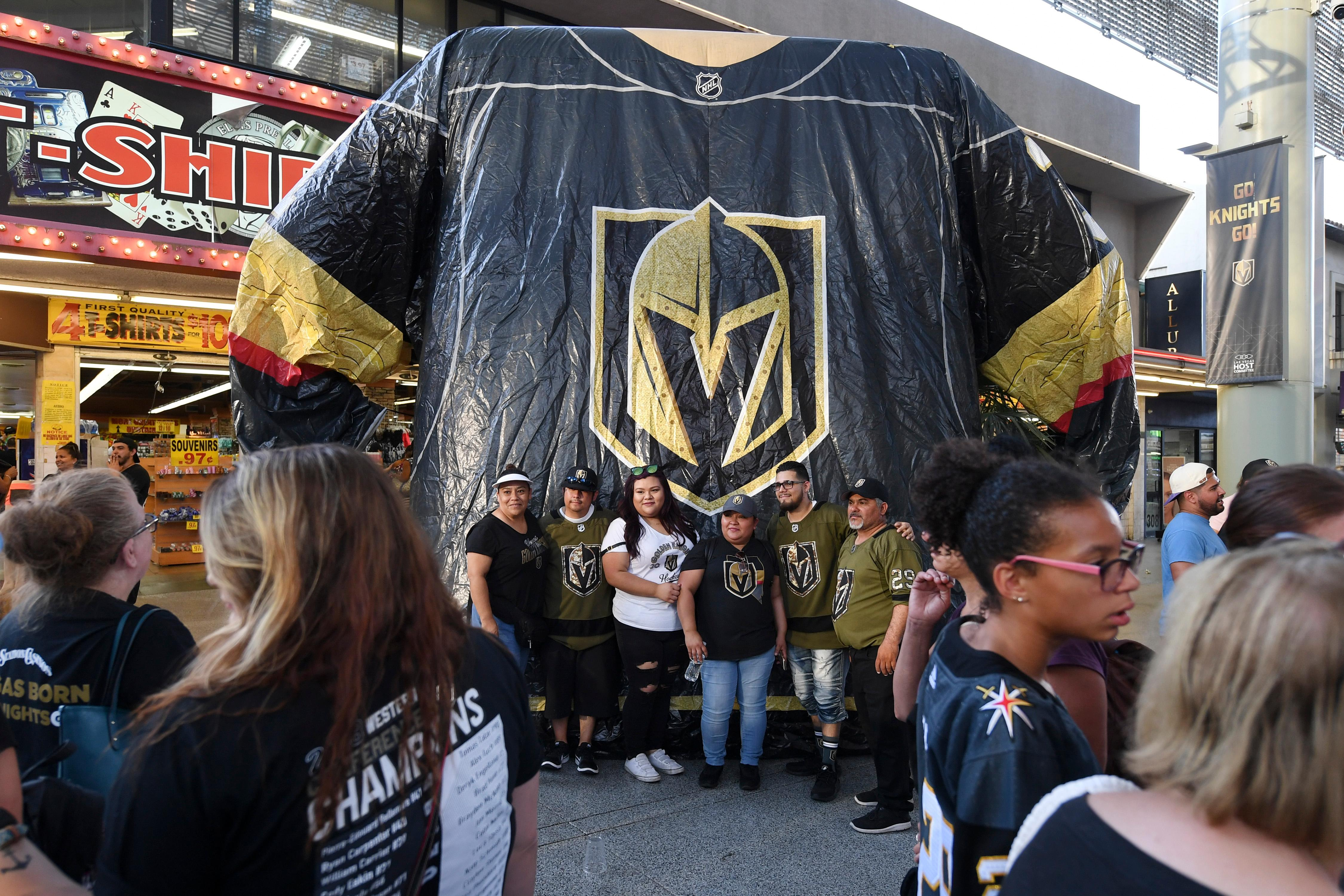 Fans have their photo taken in front of an oversized hockey sweater during a Vegas Golden Knights Stick Salute to Vegas fan appreciation rally at the Fremont Street Experience Wednesday, June 13, 2018. CREDIT: Sam Morris/Las Vegas News Bureau
