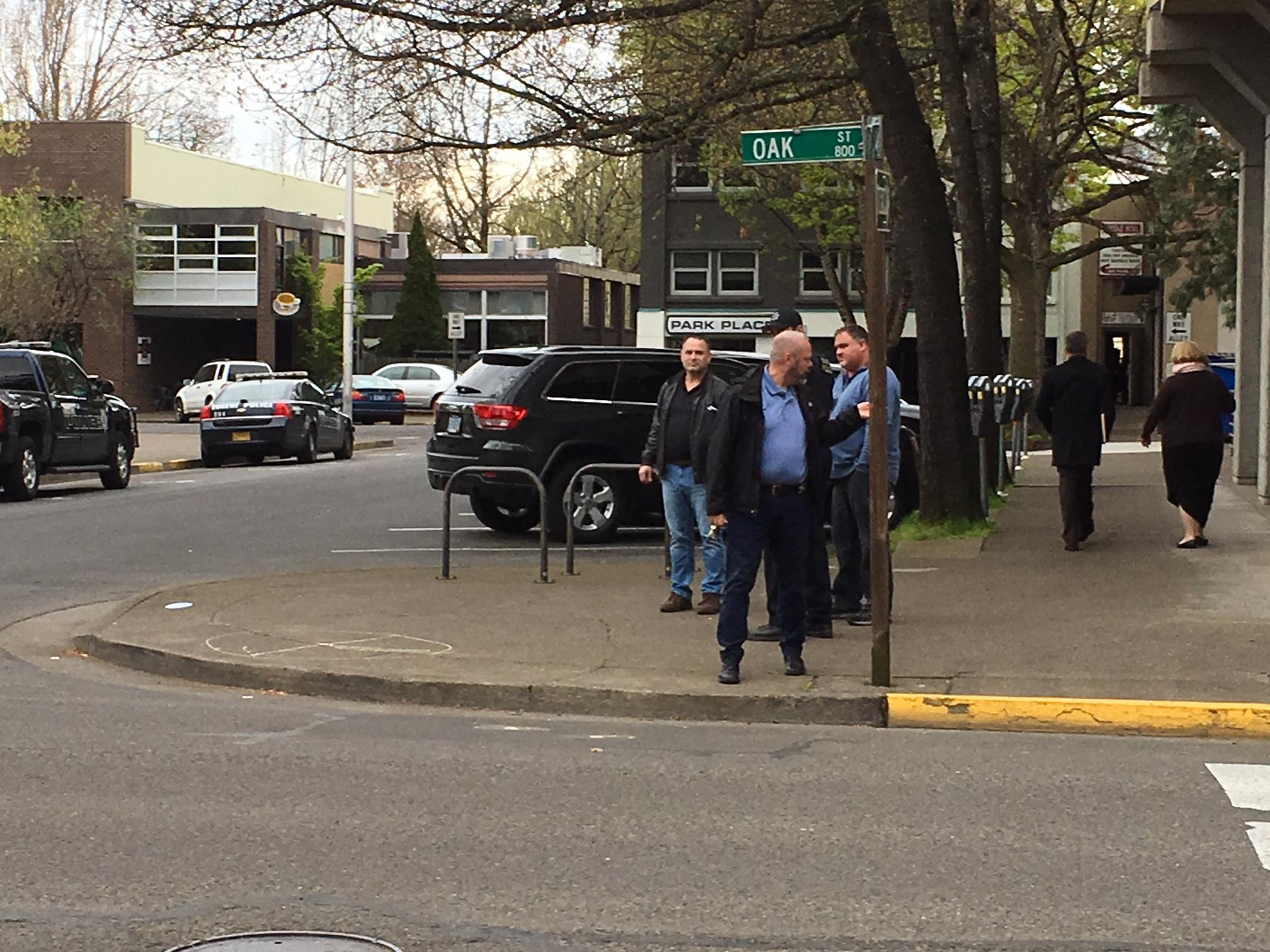 Police investigate a reported disturbance in downtown Eugene, Apr. 11, 2018. (SBG)