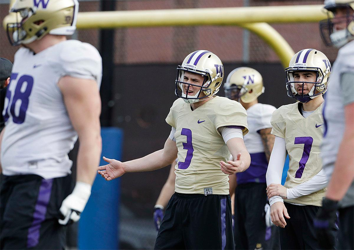 Washington quarterback Jake Browning (3) warms up with teammates during a Peach Bowl NCAA college football practice in Atlanta, Wednesday, Dec. 28, 2016. Alabama and Washington will face off in the Peach Bowl football game Saturday. (AP Photo/David Goldman)