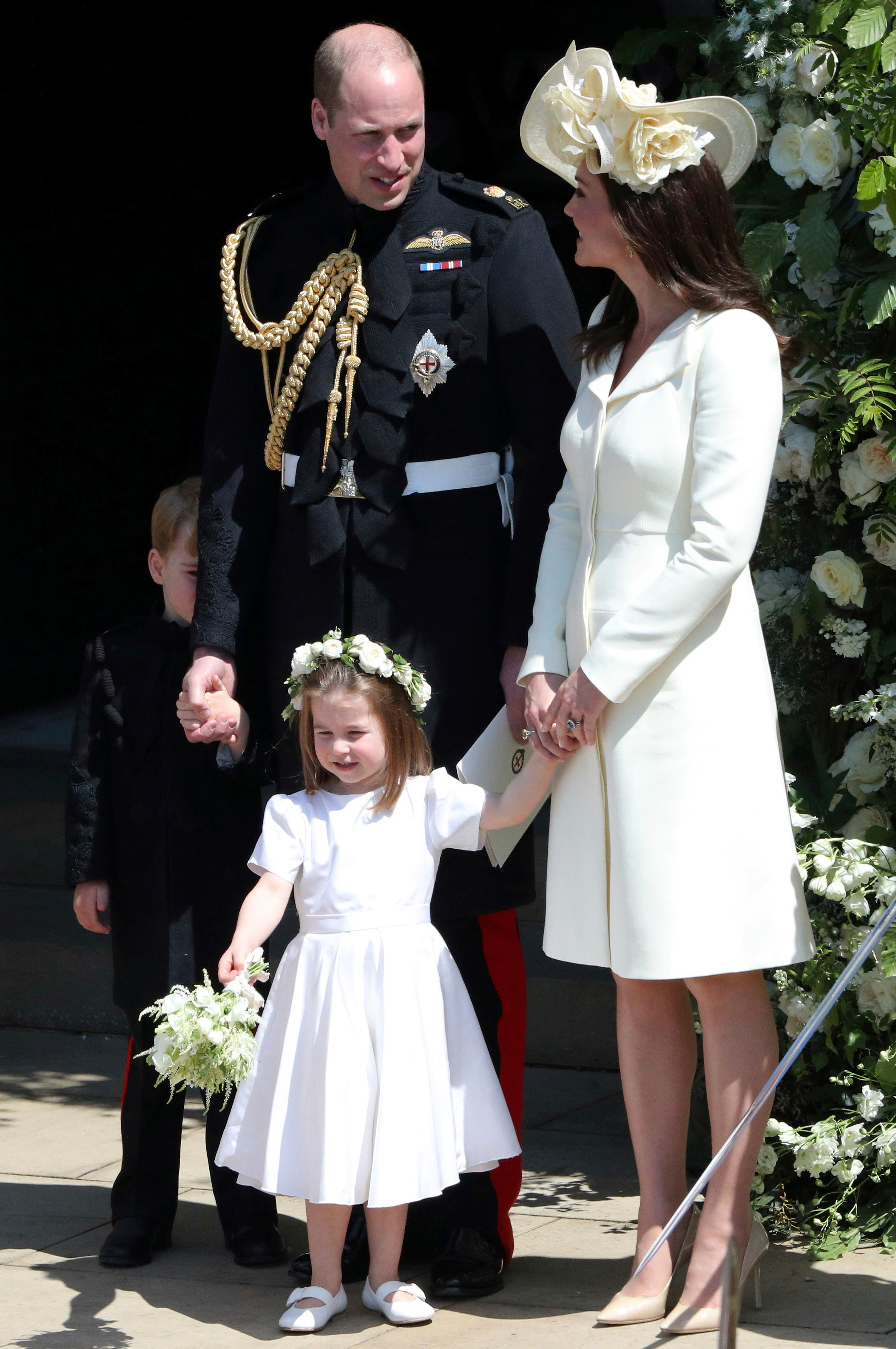 Britain's Prince William and Kate, Duchess of Cambridge with Prince George and Princess Charlotte leave St George's Chapel in Windsor Castle after the wedding of Prince Harry and Meghan Markle at St. George's Chapel in Windsor Castle in Windsor, near London, England, Saturday, May 19, 2018. (Andrew Matthews/pool photo via AP)