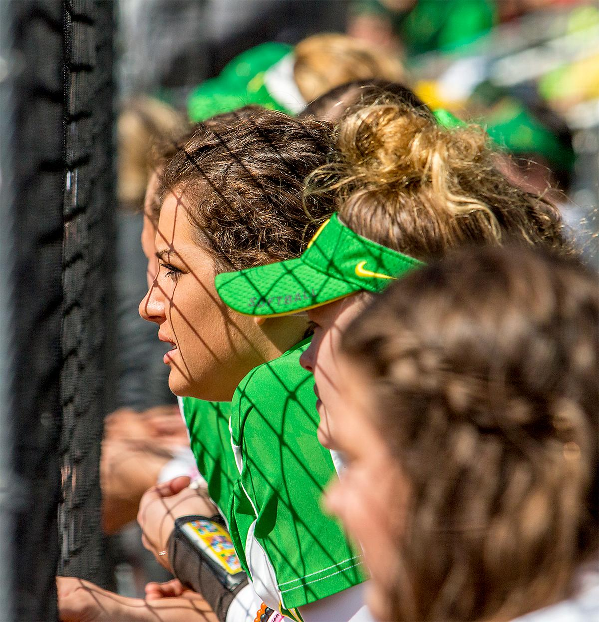 The Duck's Maggie Balint (#25) watches the game from the Duck's dugout. The Oregon Ducks Softball team took their third win over the Arizona Sun Devils, 1-0, in the final game of the weekends series that saw the game go into an eighth inning before the Duck?s Mia Camuso (#7) scored a hit allowing teammate Haley Cruse (#26) to run into home plate for a point. The Ducks are now 33-0 this season and will next play a double header against Portland State on Tuesday, April 4 at Jane Sanders Stadium. Photo by August Frank, Oregon News Lab