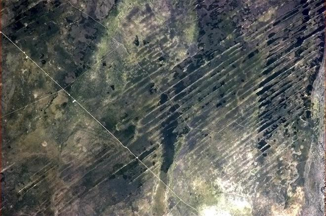 Lines on the Earth, natural and human-made, in south-central Africa. (Photo & Caption: Col. Chris Hadfield, NASA)