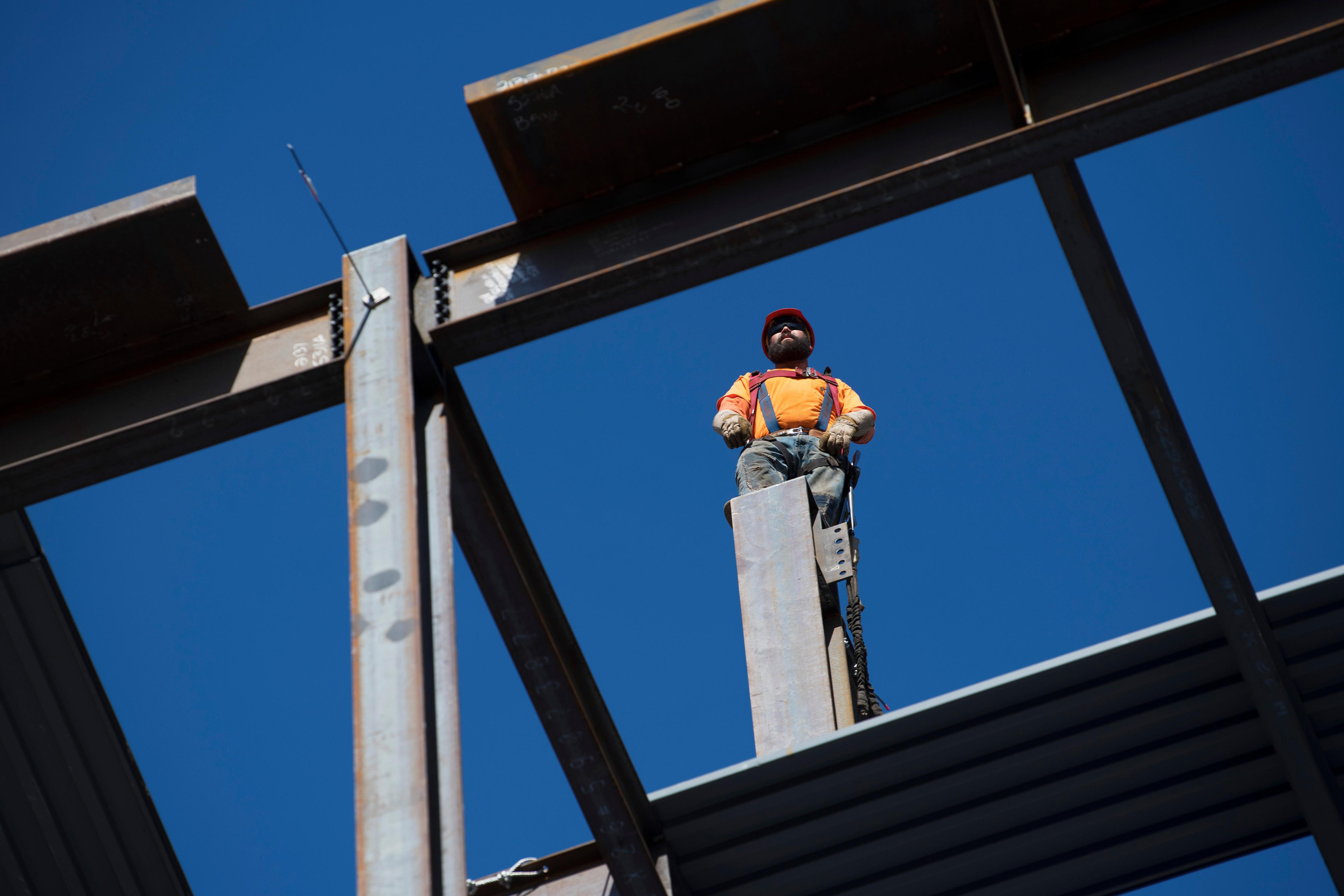 An iron worker waits for the final beam to be raised during the topping off ceremony for MGM Grand's expanded conference center Tuesday, January 30, 2018. CREDIT: Sam Morris/Las Vegas News Bureau