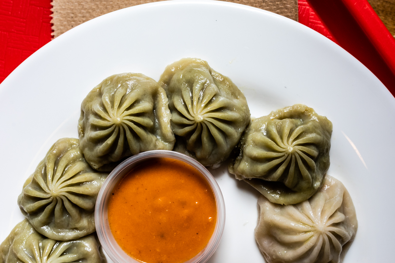 Momos: bite-size dumplings marinated in Nepali spices that are available vegan or with chicken and served with two dipping sauces / Image: Amy Elisabeth Spasoff // Published: 8.22.19