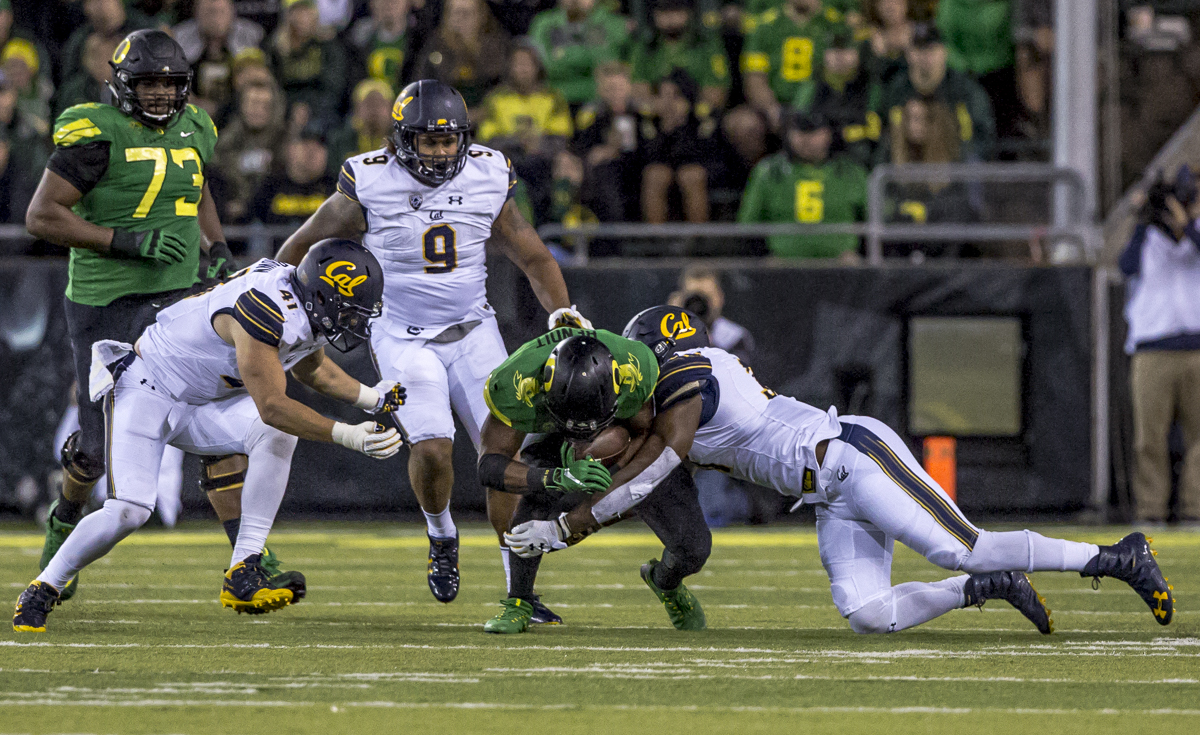 Oregon running back Kani Benoit (#29) is brought down by the California defense. The Oregon Ducks defeated the California Golden Bears 45 to 24 during an evening game on Saturday September 30, 2017. Photo by Ben Lonergan, Oregon News Lab