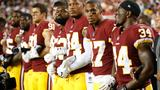 Redskins link arms with owner, kneel during national anthem in game against Raiders