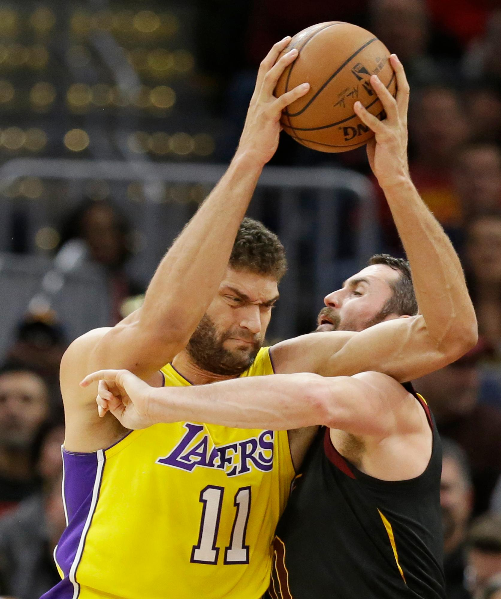 Los Angeles Lakers' Brook Lopez (11) is called for the foul against Cleveland Cavaliers' Kevin Love (0) in the first half of an NBA basketball game, Thursday, Dec. 14, 2017, in Cleveland. (AP Photo/Tony Dejak)