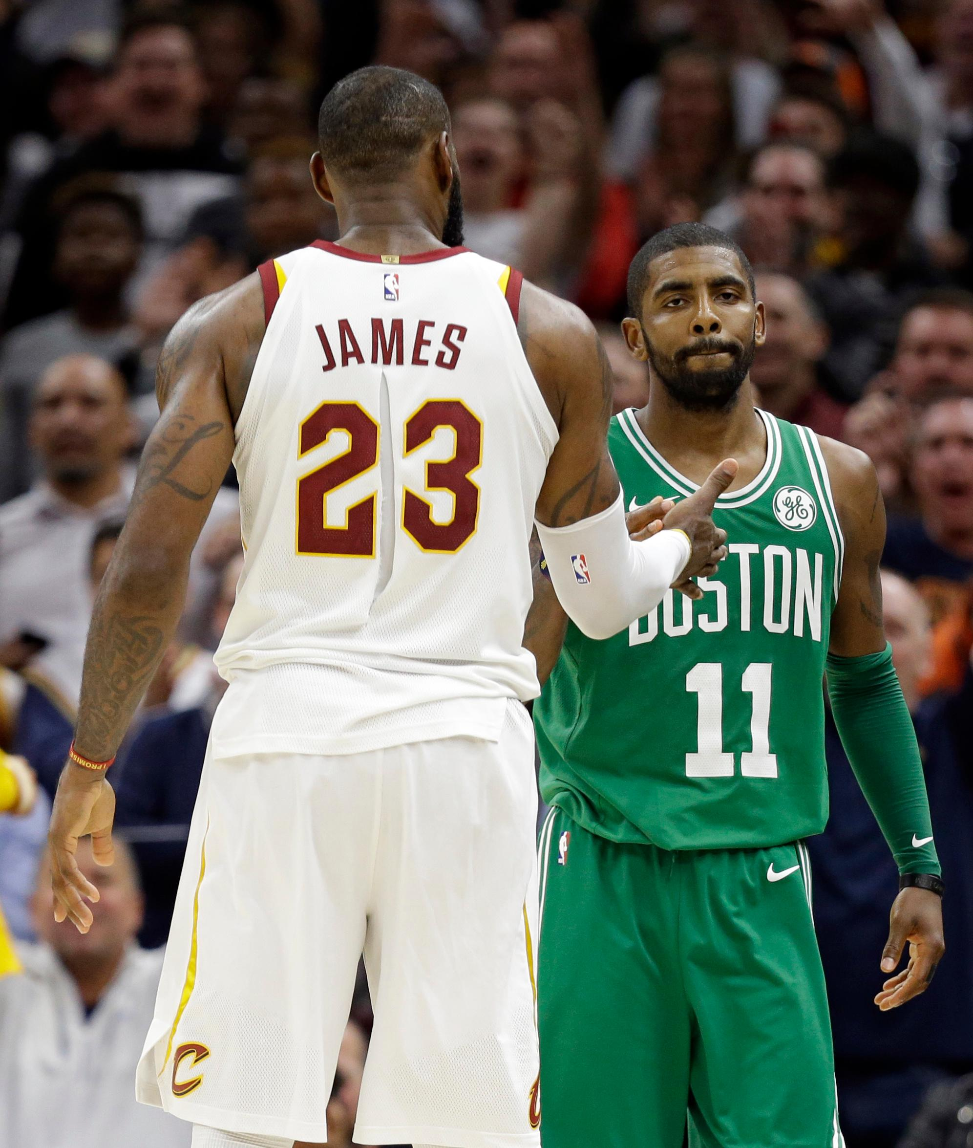 Cleveland Cavaliers' LeBron James and Boston Celtics' Kyrie Irving, right, shake hands after the Cavaliers defeated the Celtics in the second half of an NBA basketball game, Tuesday, Oct. 17, 2017, in Cleveland. The Cavaliers won 102-99. (AP Photo/Tony Dejak)