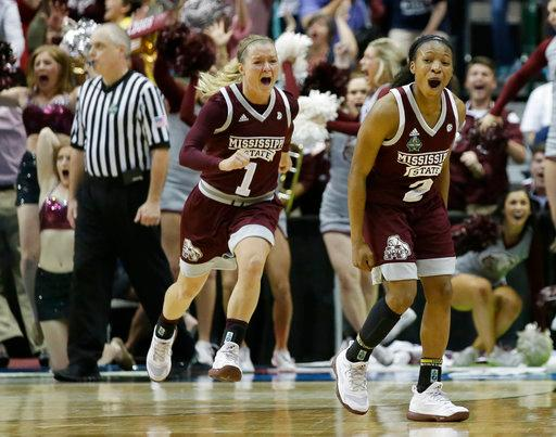 Mississippi State guard Morgan William (2) celebrates after she hit the winning shot in overtime to defeat Connecticut in an NCAA college basketball game in the semifinals of the women's Final Four, Friday, March 31, 2017, in Dallas. Mississippi State won 66-64. (AP Photo/LM Otero)