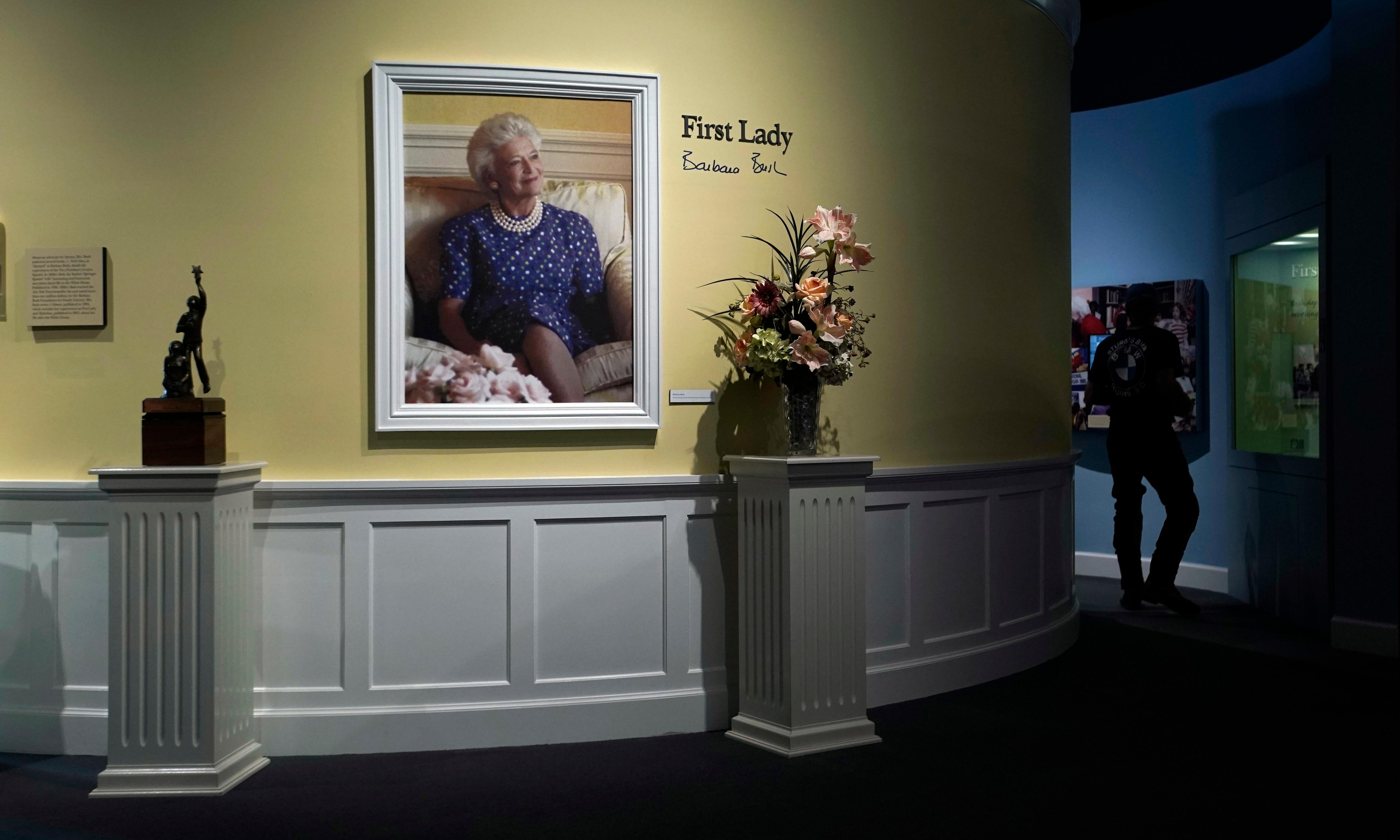 Visitors walk through an exhibit for former first Lady Barbara Bush at the George Bush Presidential Library and Museum Wednesday, April 18, 2018, in College Station, Texas. Barbara Bush died Tuesday, April 17, 2018, at the age of 92. (AP Photo/David J. Phillip)