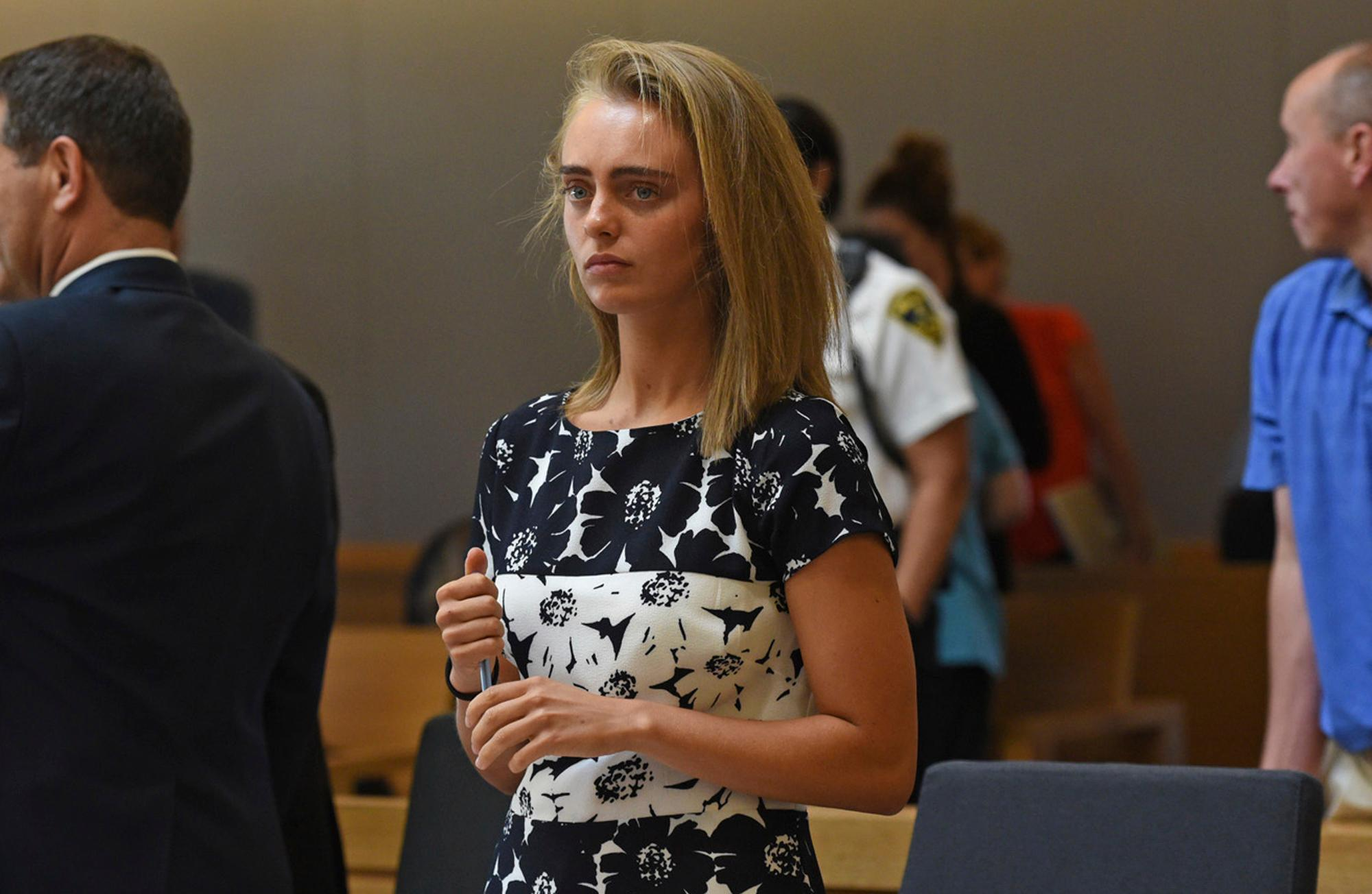 FILE - In this Monday, June 12, 2017 file photo, Michelle Carter stands as court is in recess at the end of the day at her trial in Taunton, Mass. Carter is charged with involuntary manslaughter for encouraging Conrad Roy III to kill himself in July 2014. The judge is set to issue a verdict in the case on Friday. (Faith Ninivaggi/The Boston Herald via AP, Pool, File)