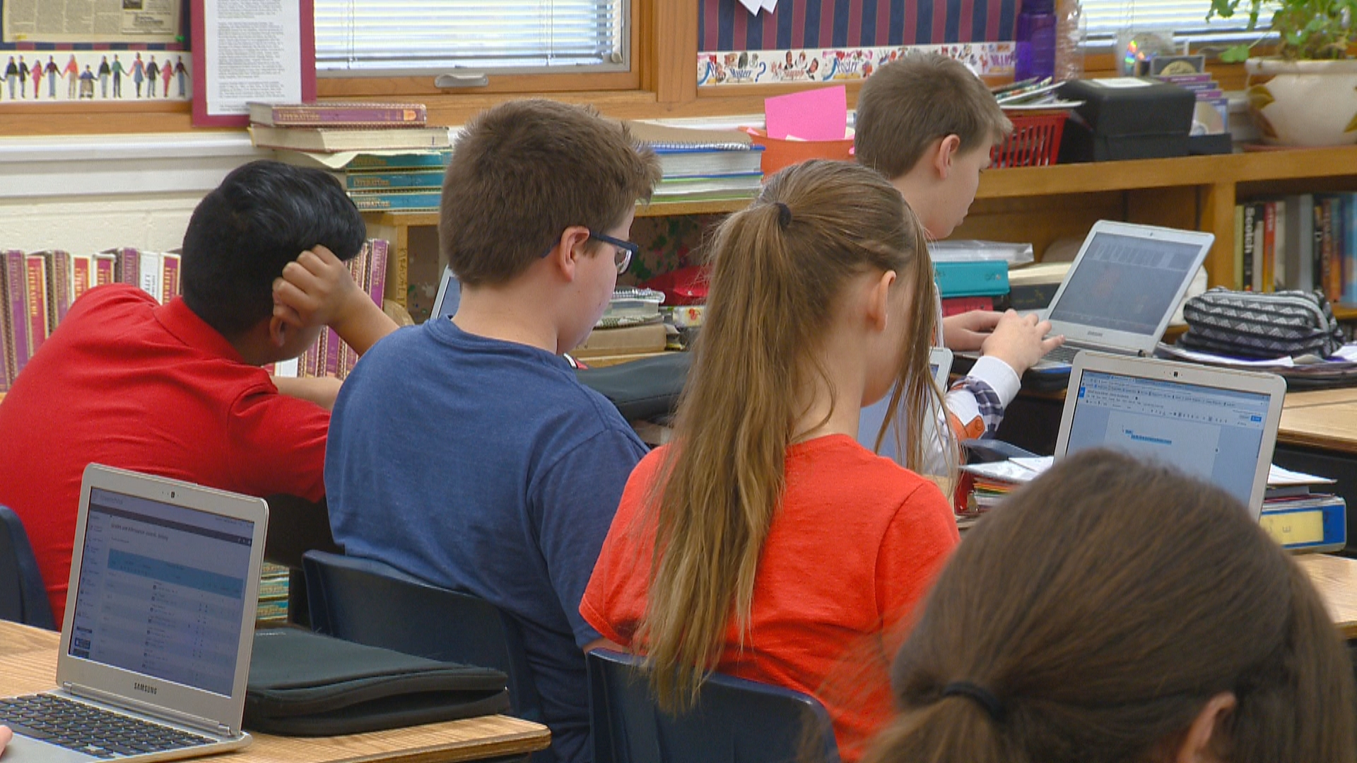 "Students at Holy Family Elementary in Green Bay are challenging themselves and the community to ""Snap Out of It,"" and go without electronics for 24 hours, February 2018. (WLUK)"