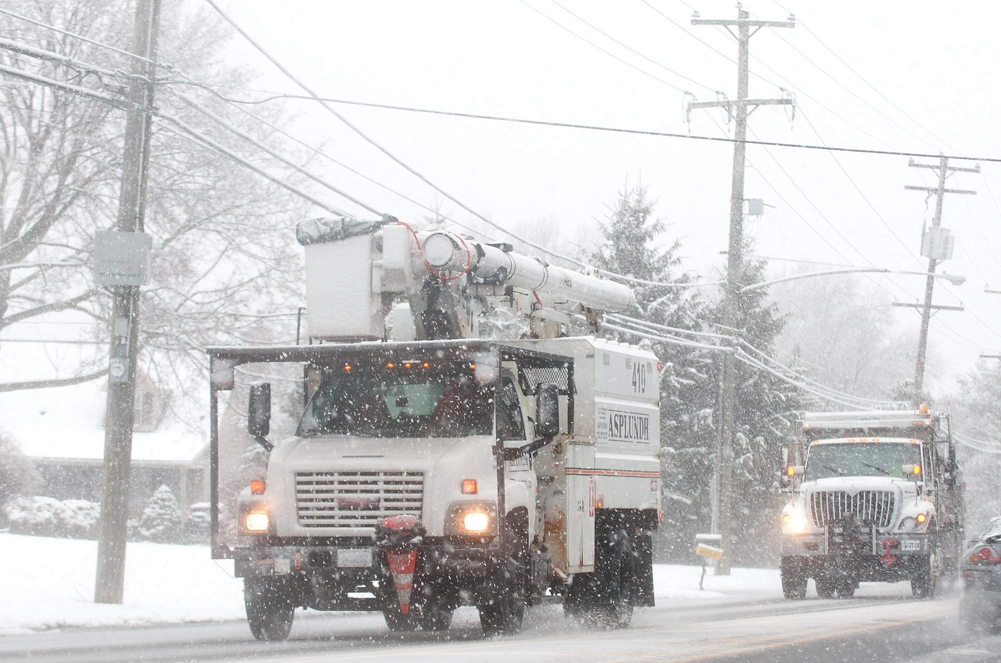 A tree trimming crew and a Northampton Township Public Works truck travel along Second Street Pike during the second nor'easter Wednesday, March 7, 2018 in Richboro. [BILL FRASER / STAFF PHOTOJOURNALIST]
