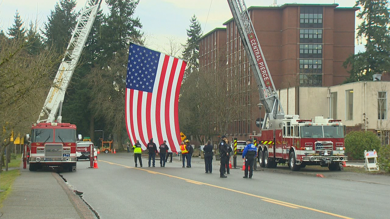 flag.pngAn American flag is draped near the end of the procession. Olson Auditorium, where the memorial will take place, is nearby. (Photo: KOMO News)
