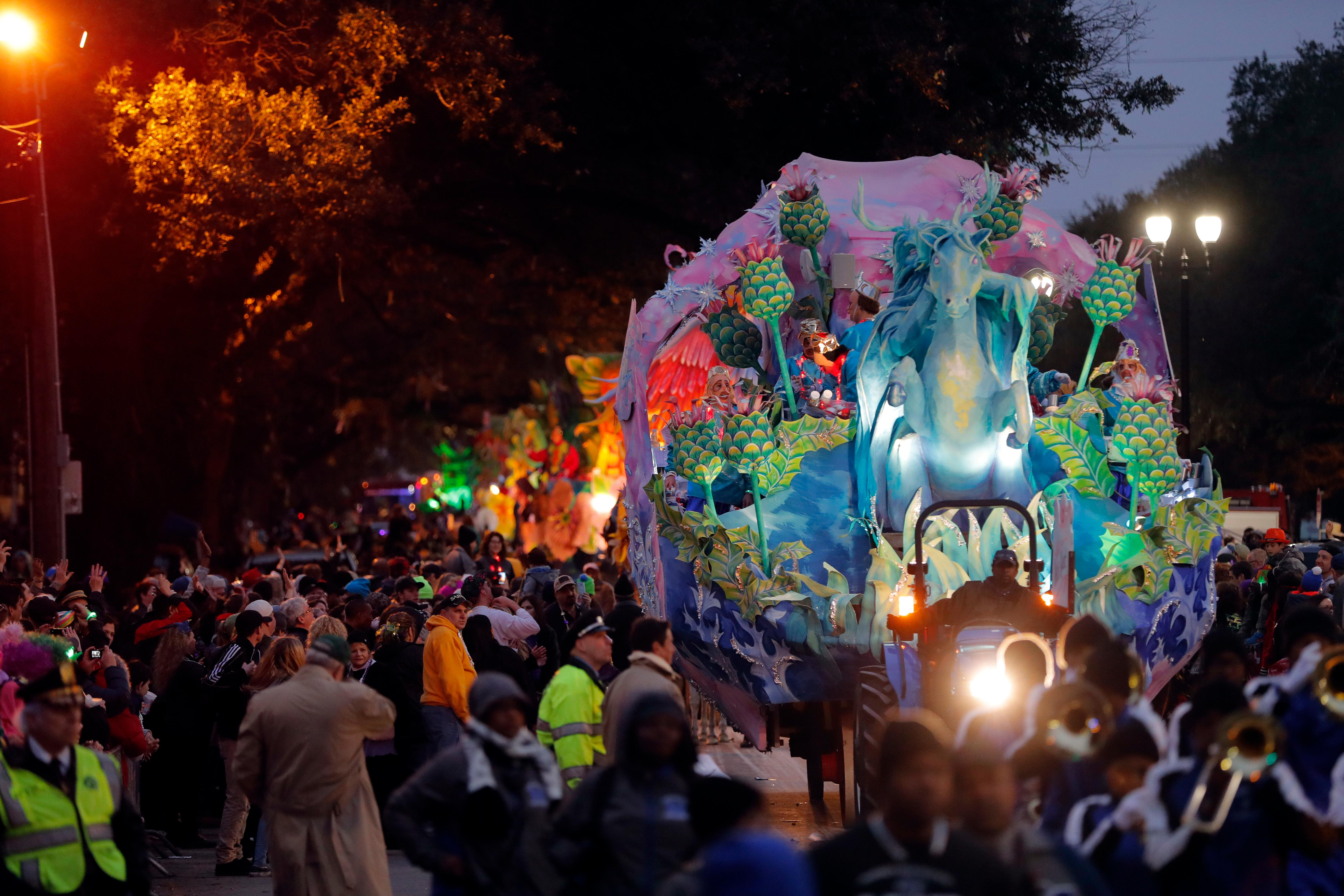 The Krewe of Orpheus rolls in New Orleans, Monday, Feb. 12, 2018. Tens of thousands of revelers are expected on New Orleans streets for parades and rowdy fun as Mardi Gras caps the Carnival season in a city with a celebration of its own, its 300th anniversary. (AP Photo/Gerald Herbert)