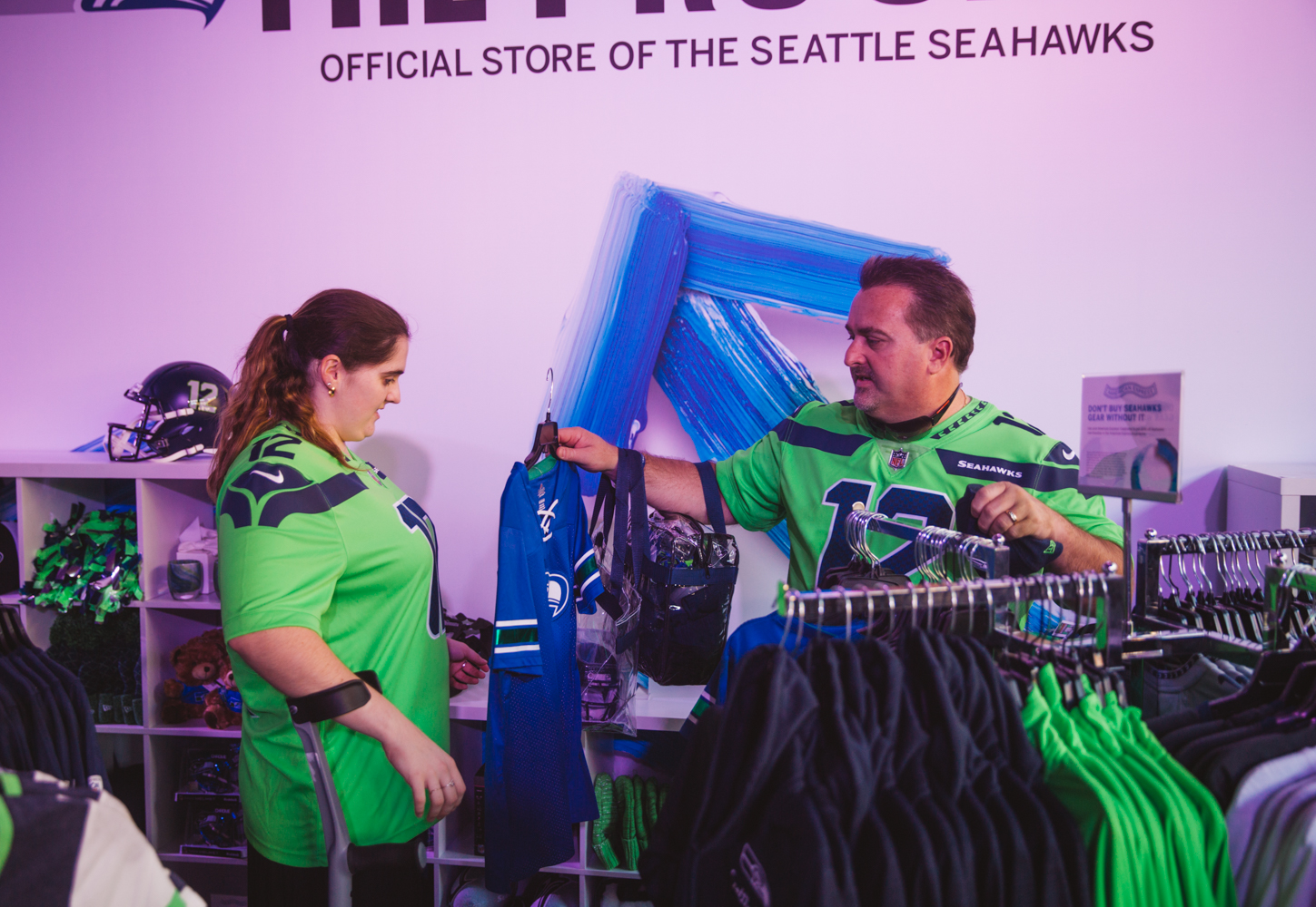There was an extra special pre-game Hawks celebration today (Sept. 22) near CenturyLink Field - and this one was just for AMEX Express Card Members. The 'American Express Experience' boasted an assortment of on-site activities, like photo opps, a Giant Seahawks Throne made of helmets and footballs, wings mural, food, a pro-shop discount, and even an appearance by legend Steve Largent. The Experience will be open to all fans before every Seahawks home game. (Image: Ryan McBoyle / Seattle Refined)