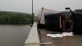 Bridge reopens after strong winds knock tractor trailer over