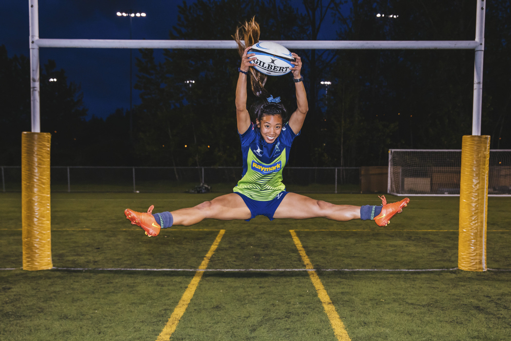 "This is Erica! Eric dabbles in both Wing Half and Scrum Half. Her favorite show is How I Met Your Mother, her favorite snack is Boom Chicka Pop Sweet and Salty popcorn preferably ""the size of her body."" (Image: Sunita Martini / Seattle Refined)."