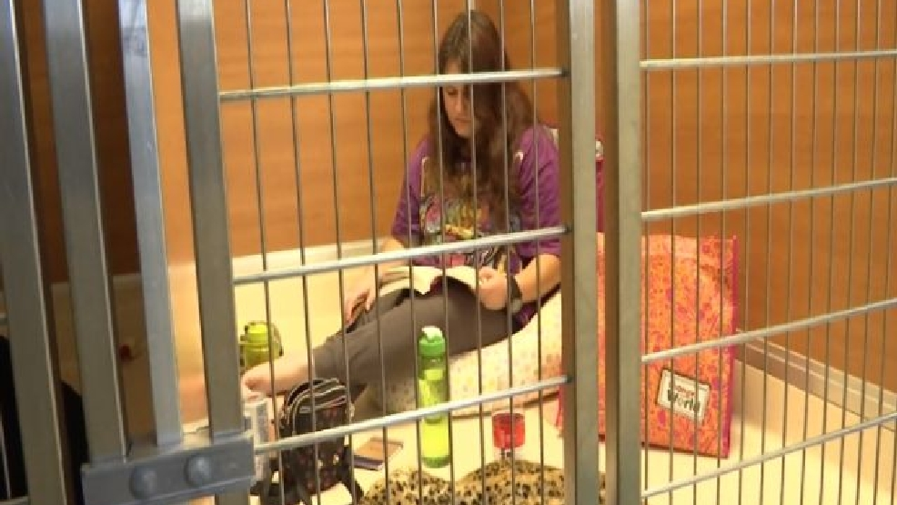 Volunteers Spend 24 Hours Locked In Kennel Cages For