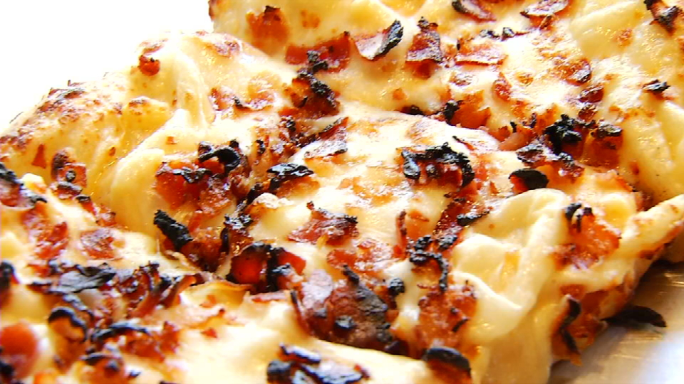 This is cheese bread is called &quot;The Philly,&quot; which is served with balsamic onions, Mozzarella, and thinly sliced rib-eye (News 4 San Antonio)<p></p>