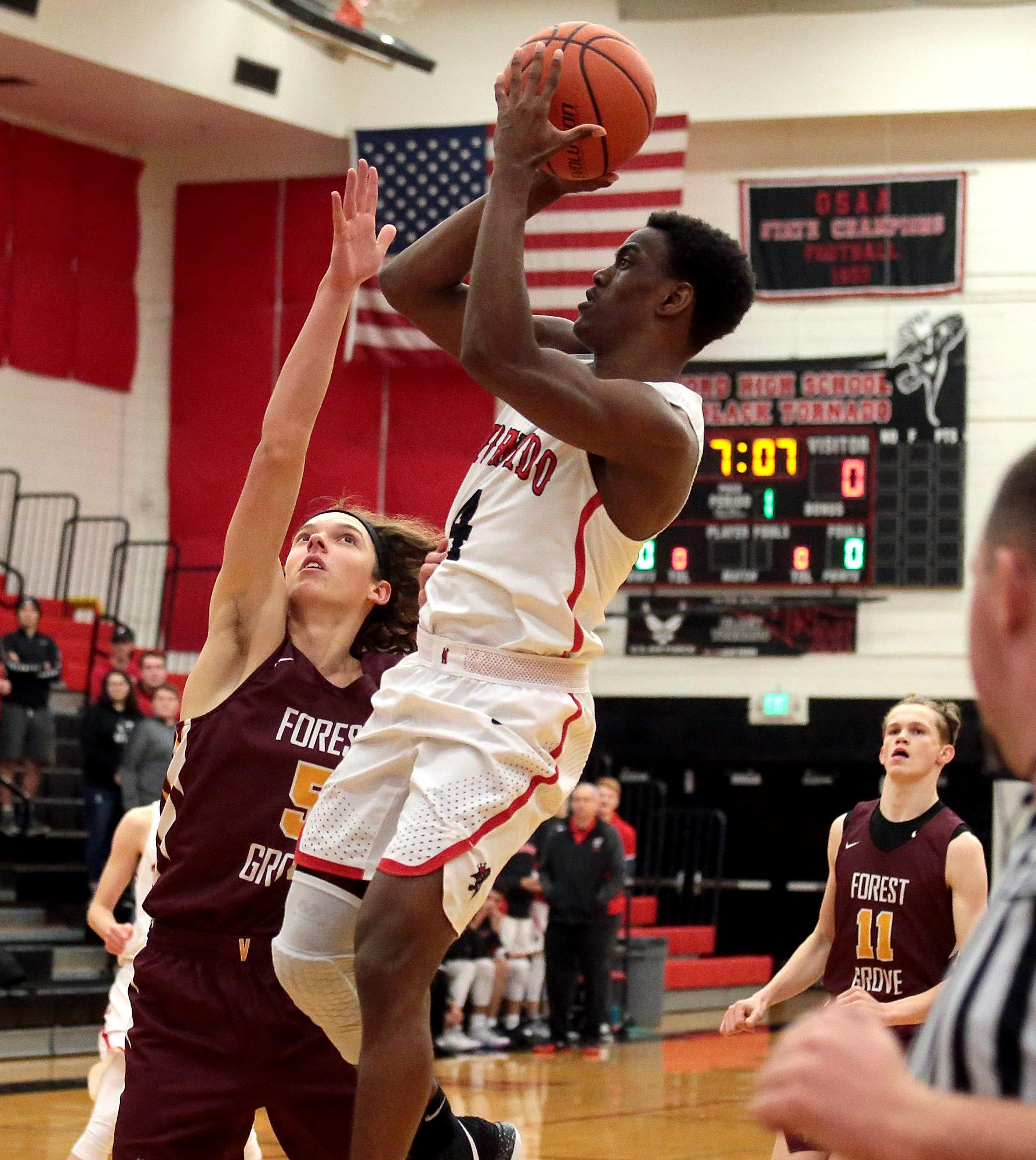 North Medford senior Jaray Thomas attempting to shoot against Forest Grove on the Opening night of the 2018 Abby's Holiday Classic at North Medford High on Thursday.(PHOTO BY:  LARRY STAUTH JR)