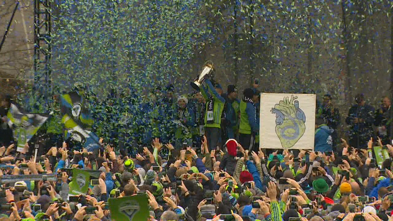 Seattle Sounders players hoist the MLS Cup at a rally at Seattle Center on Dec. 13, 2016 (Photo: KOMO News)