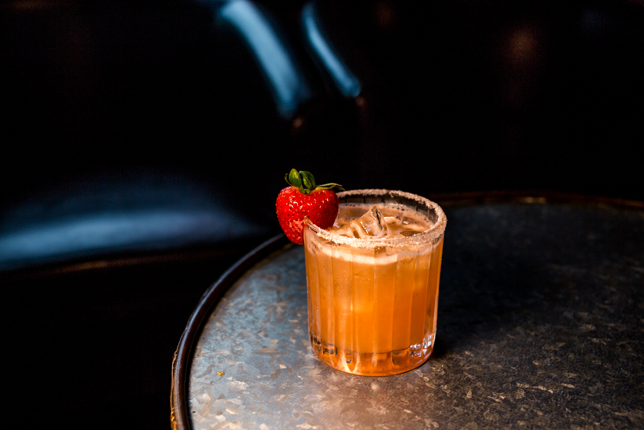 The 1841: Woodford Reserve Bourbon, Cointreau, strawberry simple syrup, apple cider, lemon juice, with a sugared rim, and garnished with a strawberry / Image: Catherine Viox // Published: 7.30.19