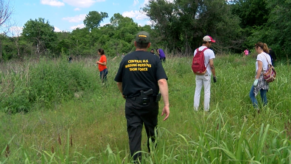 Dozens of volunteers help in the search of a missing Tulsa