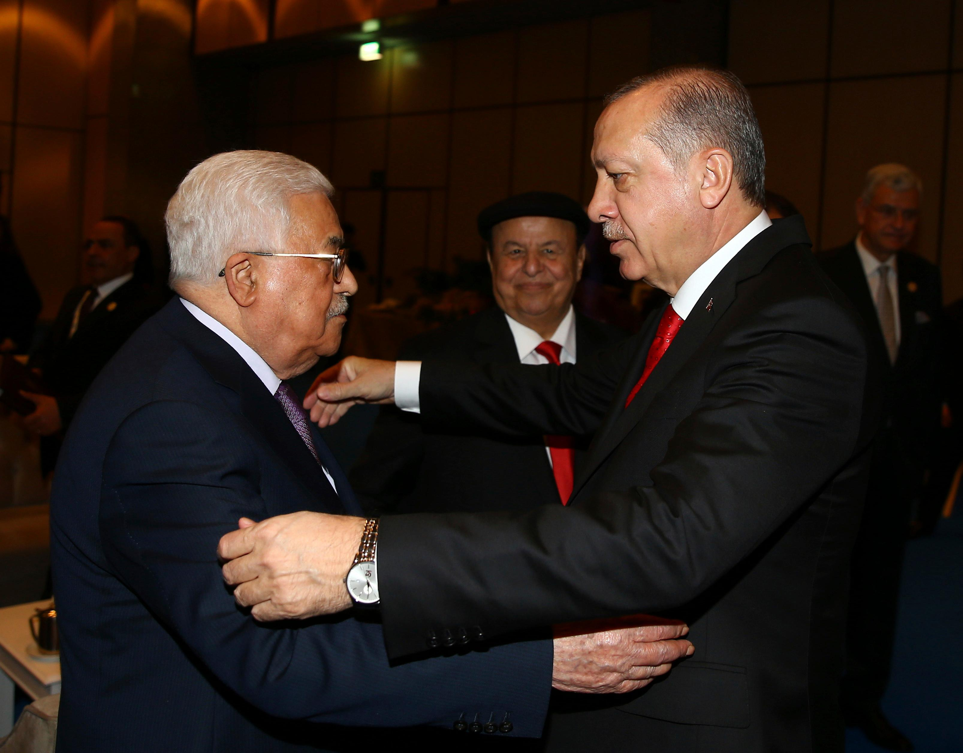 "Turkey's President Recep Tayyip Erdogan, right, welcomes Palestinian President Mahmoud Abbas, left, prior to the opening session of the Organisation of Islamic Cooperation Extraordinary Summit in Istanbul, Wednesday, Dec. 13, 2017. Leaders and high-ranking officials of Muslim countries met in Istanbul to discuss the U.S. recognition of Jerusalem as Israel's capital. Erdogan_ term president of OIC, the umbrella organisation of 57-members, has been vehemently critical of the U.S. move and said the leaders would relay a ""strong message."" (Kayhan Ozer/Pool Photo via AP)"