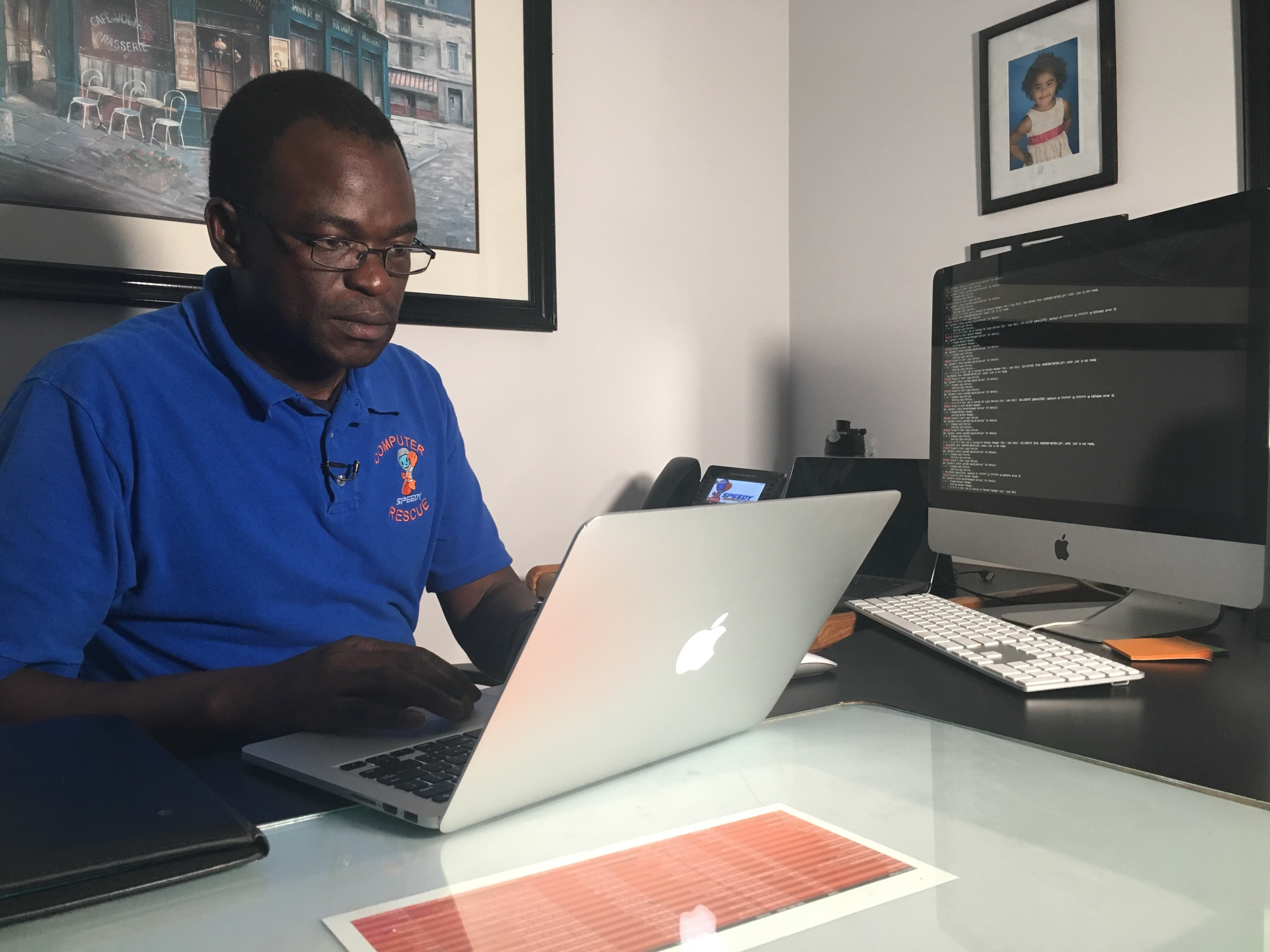Steve Opoku, president of Speedy Computer Rescue, demonstrates how easily hackers can access personal information. Photo taken Oct. 9, 2019. (WWMT/Genevieve Grippo)