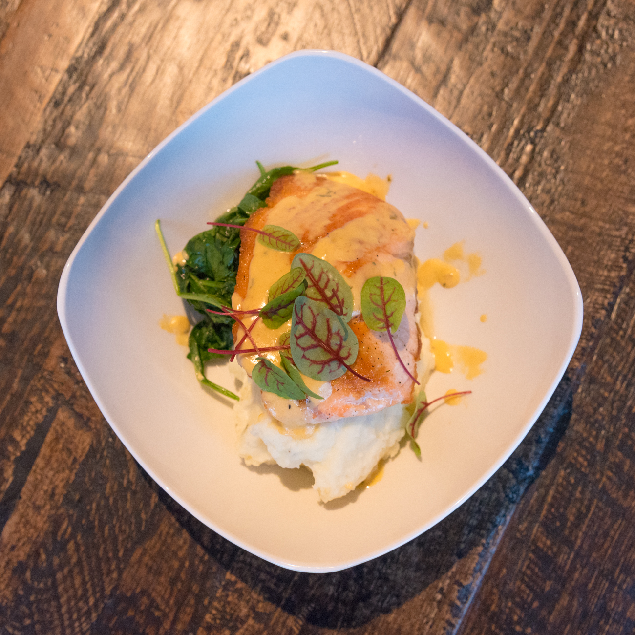 Salmon: Atlantic salmon, roasted garlic & thyme smashed potatoes, sauteed spinach, and lobster cream sauce / Image: Phil Armstrong, Cincinnati Refined // Published: 12.14.16