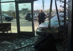 Authorities investigate after a car crashed into the front window of Vision Mart on Oneida Street in Ashwaubenon April 18, 2017.