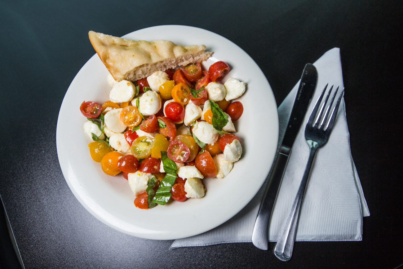 Caprese salad: fresh mozzarella, tomatoes, basil, sea salt, and extra virgin olive oil / Image: Catherine Viox // Published: 6.17.19