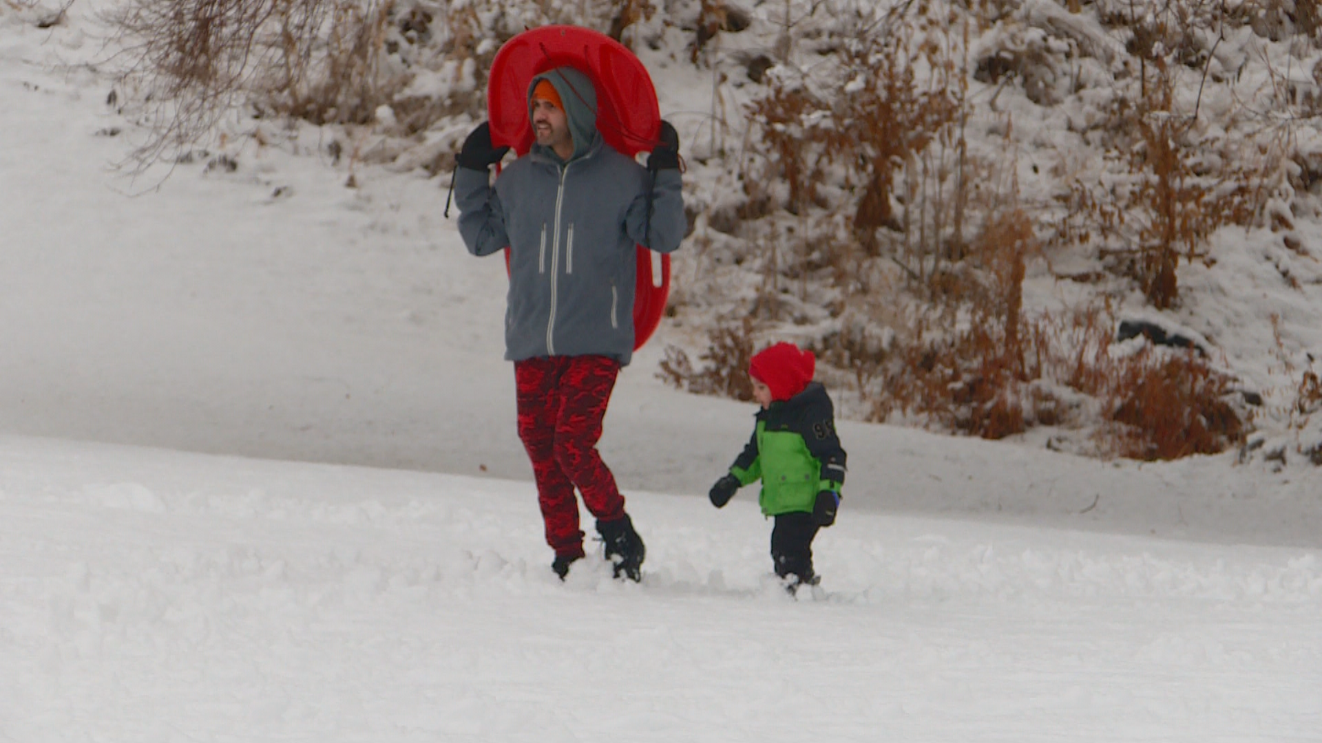 Kids at Sugarhouse Park embrace the Thanksgiving snow. (Photo: Ginna Roe, KUTV)
