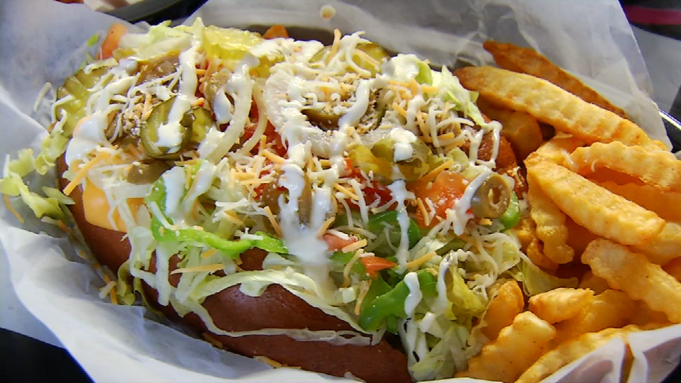 Here we have{&amp;nbsp;} the specialty of the house which is huge sandwich served with ham, cheese, lettuce, tomatoes, onion and with funky fries (News 4 San Antonio)<p></p>
