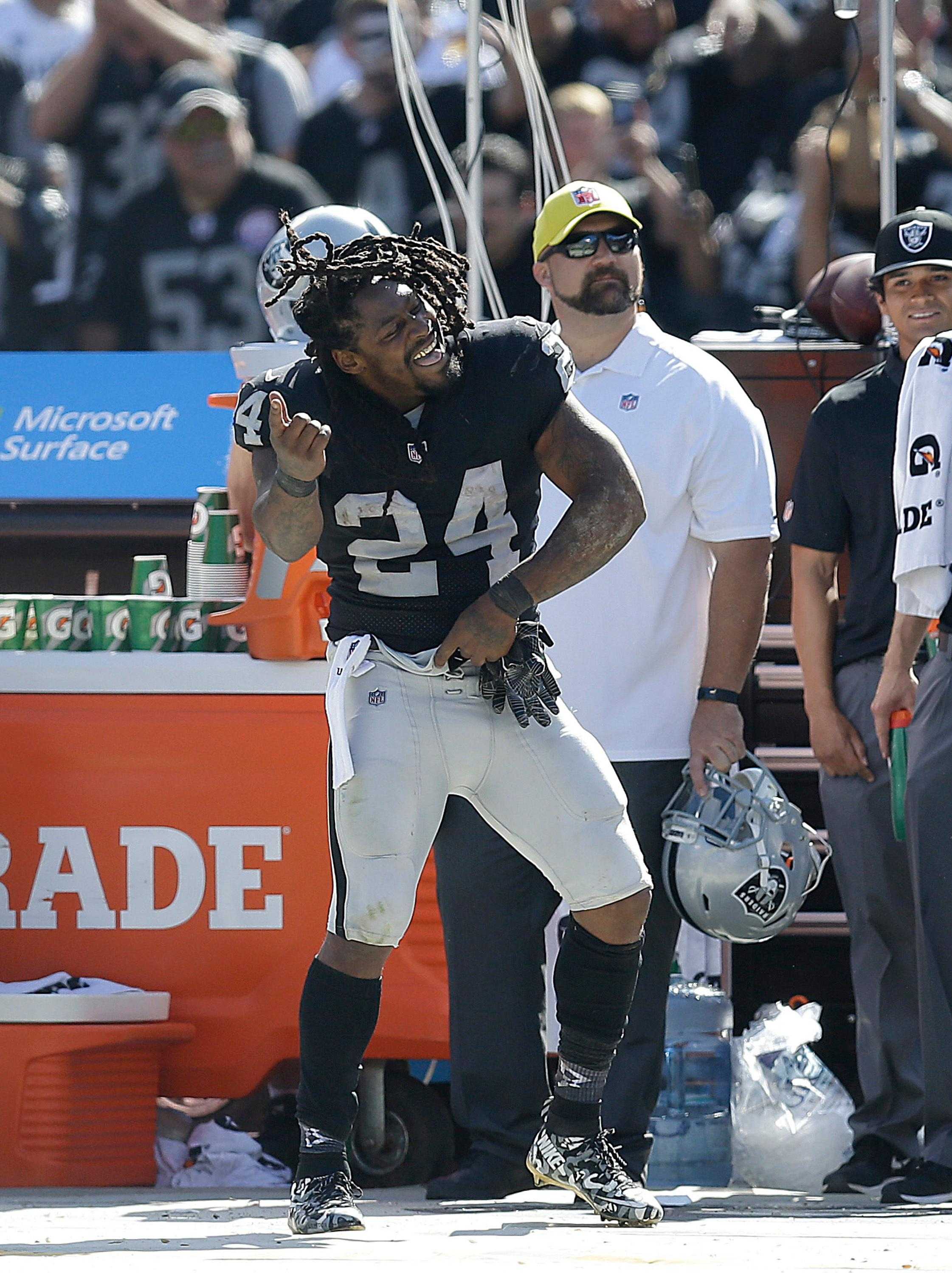 Oakland Raiders running back Marshawn Lynch (24) dances on the sideline during the second half of an NFL football game against the New York Jets in Oakland, Calif., Sunday, Sept. 17, 2017. (AP Photo/Ben Margot)
