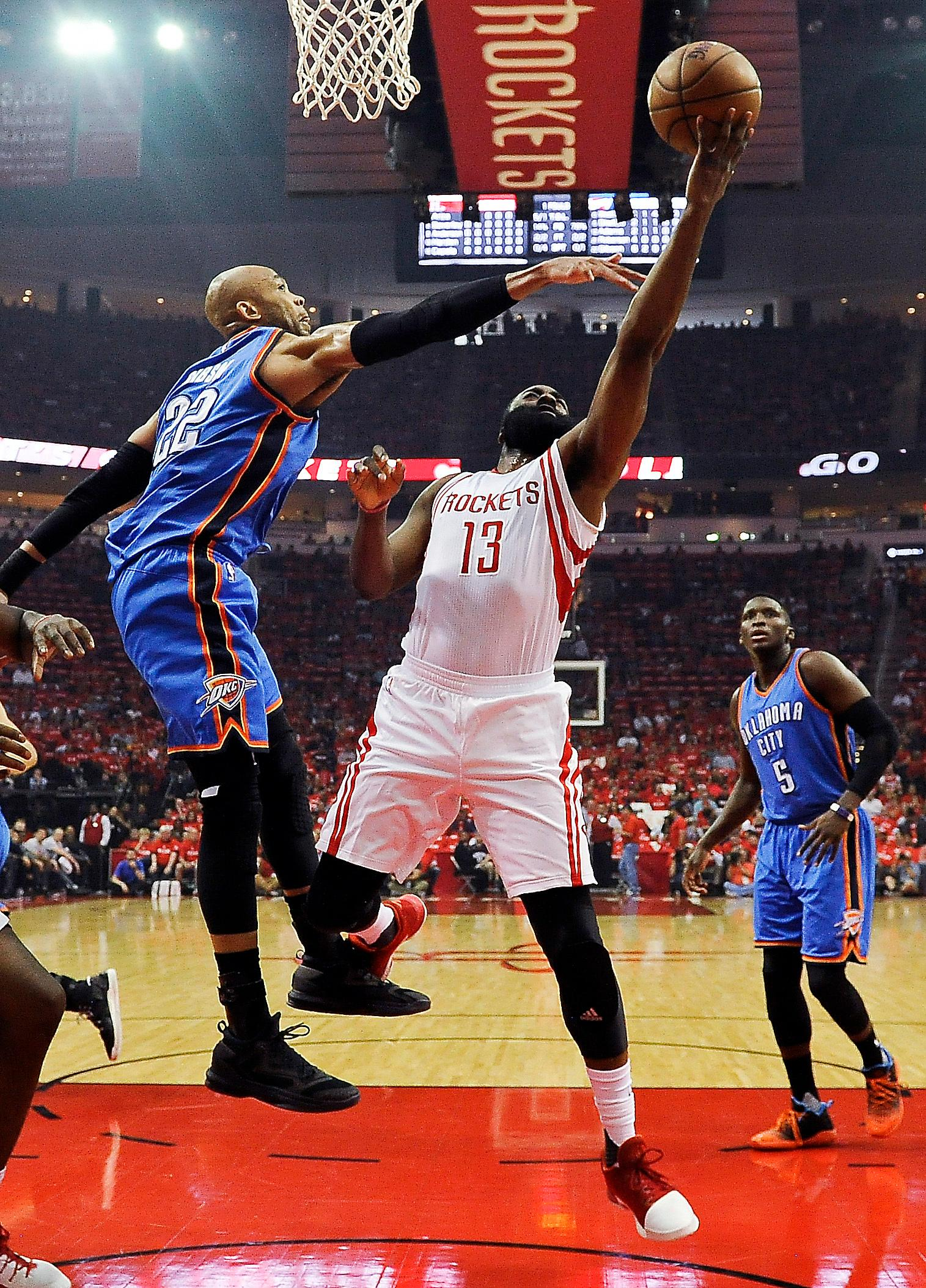 Houston Rockets guard James Harden (13) shoots as Oklahoma City Thunder forward Taj Gibson defends during the first half in Game 2 of an NBA basketball first-round playoff series, Wednesday, April 19, 2017, in Houston. (AP Photo/Eric Christian Smith)