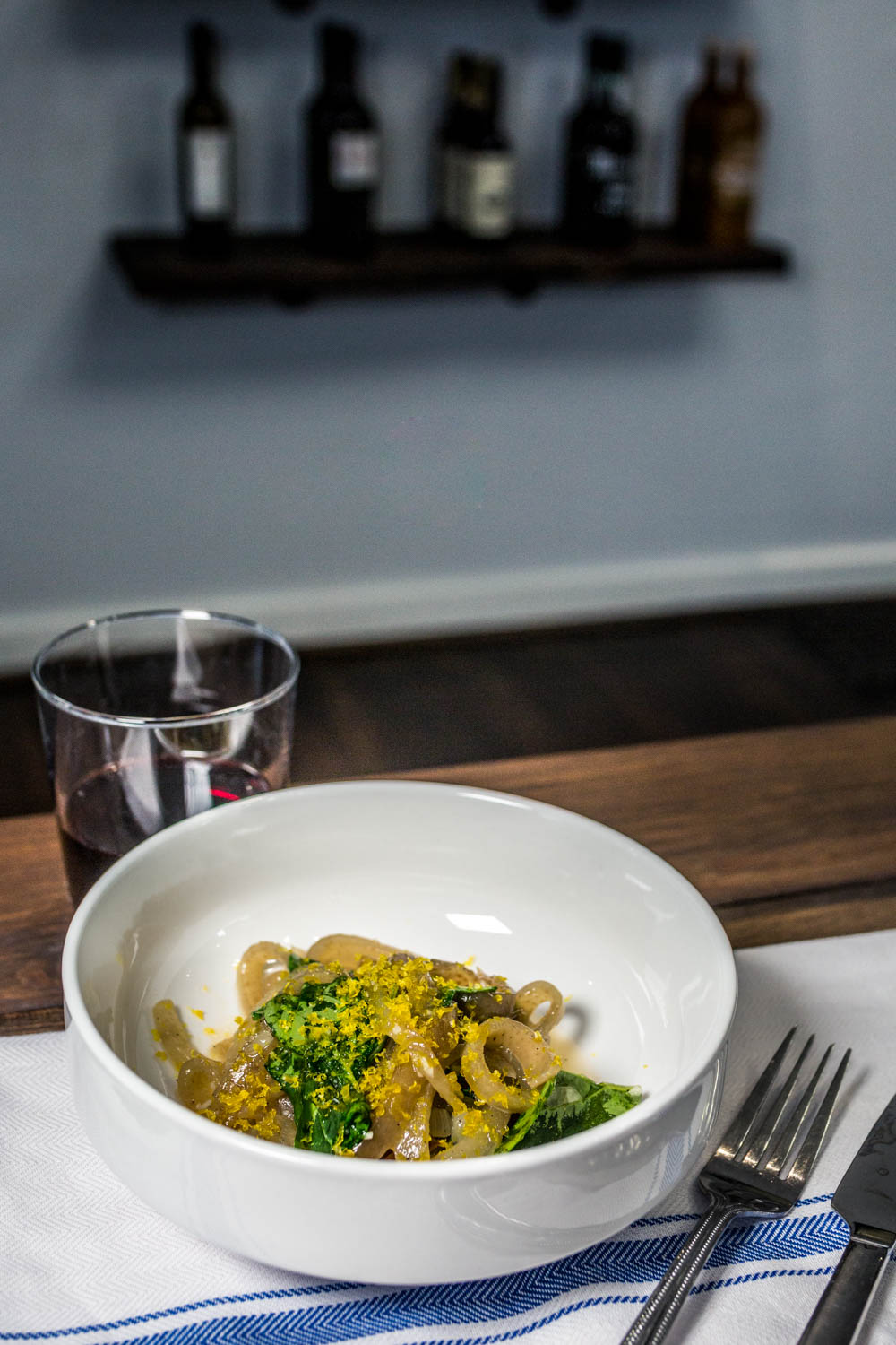 Pig Skin Carbonara: hand-sliced pig skin noodles tossed lightly in white wine and butter with arugula and topped with grated cured egg yolk / Image: Catherine Viox{ }// Published: 10.16.19